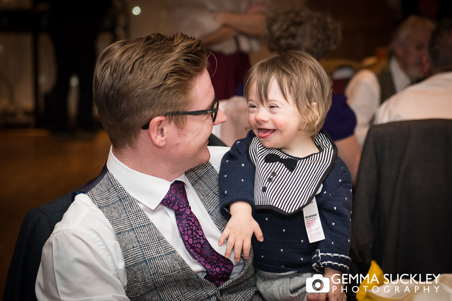 little boy and his dad during wedding speeches