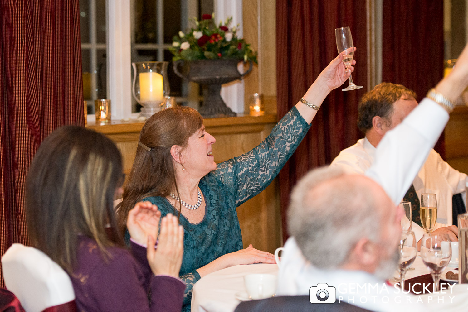 wedding guest toasting during wedding speeches at The Devonshire arms in Bolton Abbey