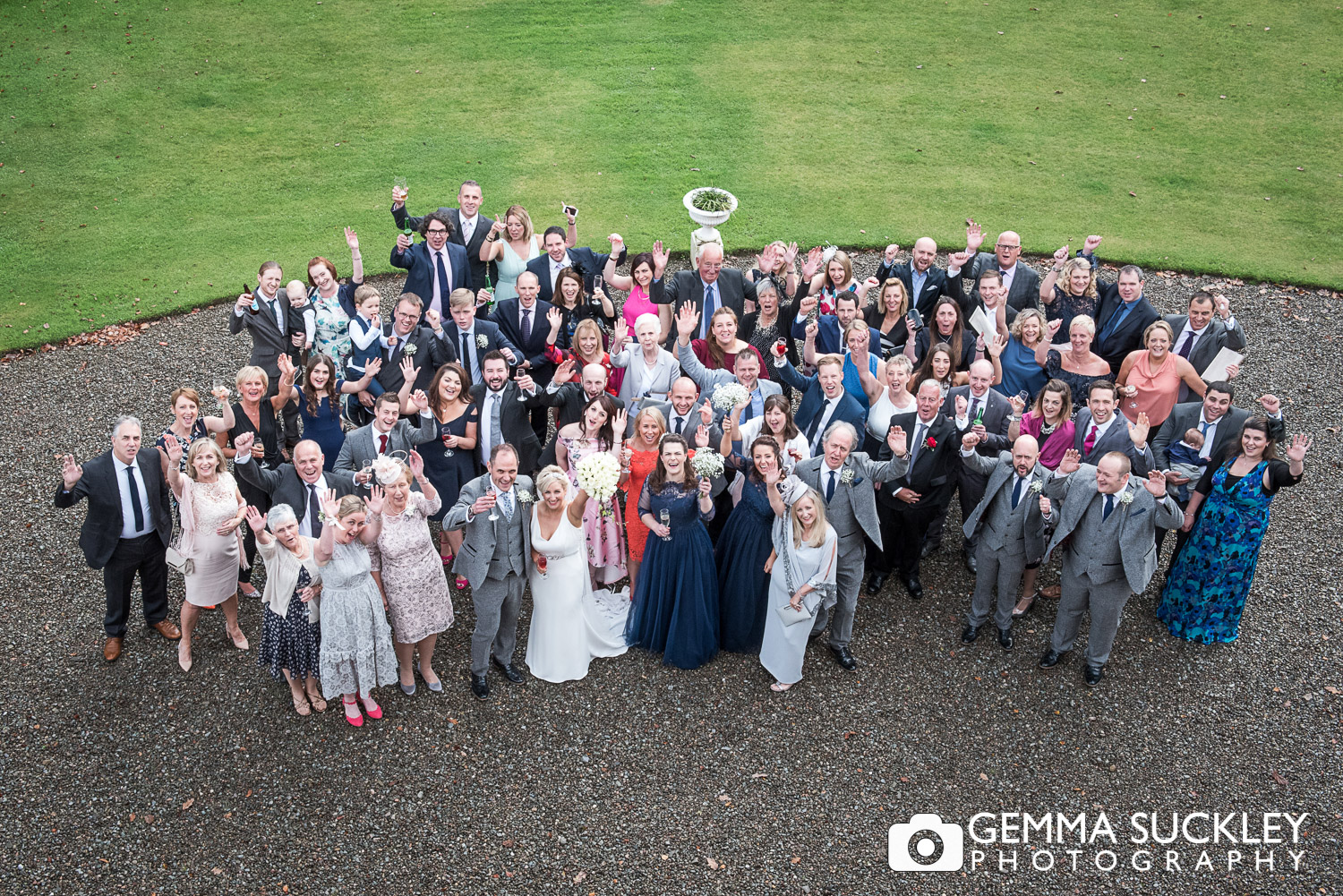 Group photo from above of all the wedding guests from the window of Belmount Hall