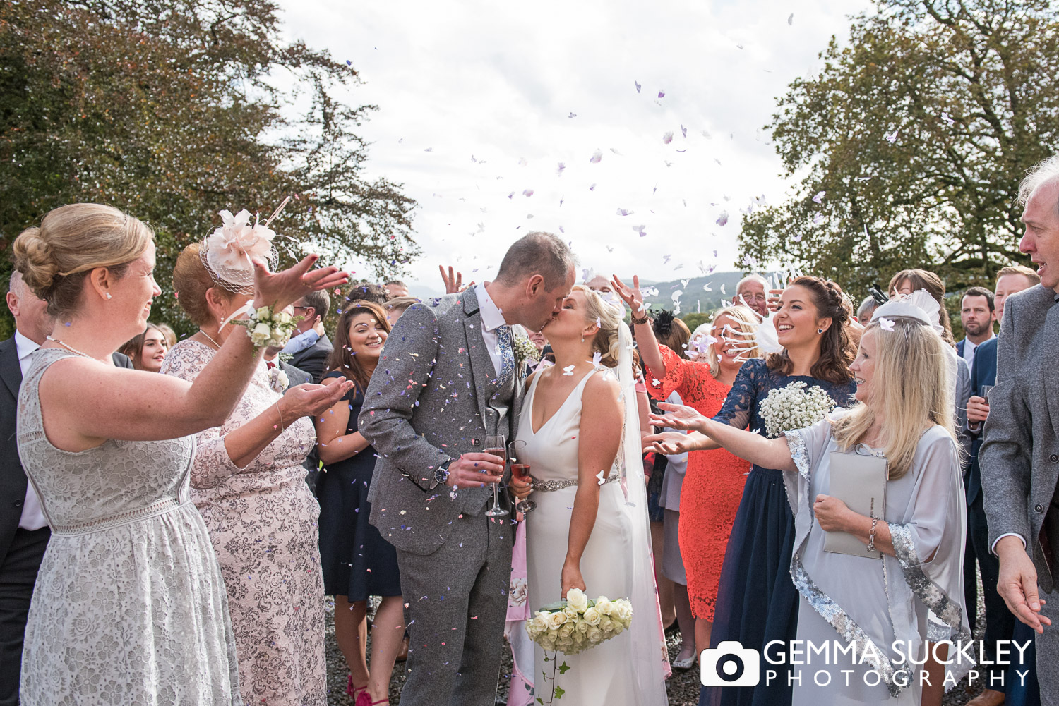 wedding guests throwing confetti outside belmount Hall