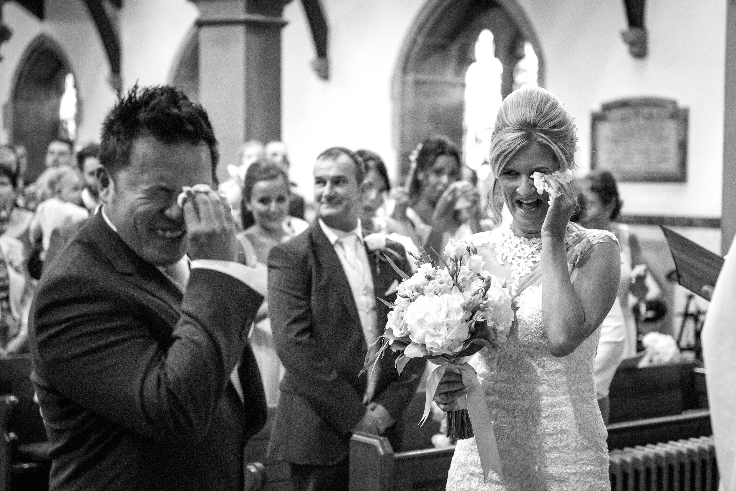 emotion bride and groom in a chuch in bradford before saying their wedding vows
