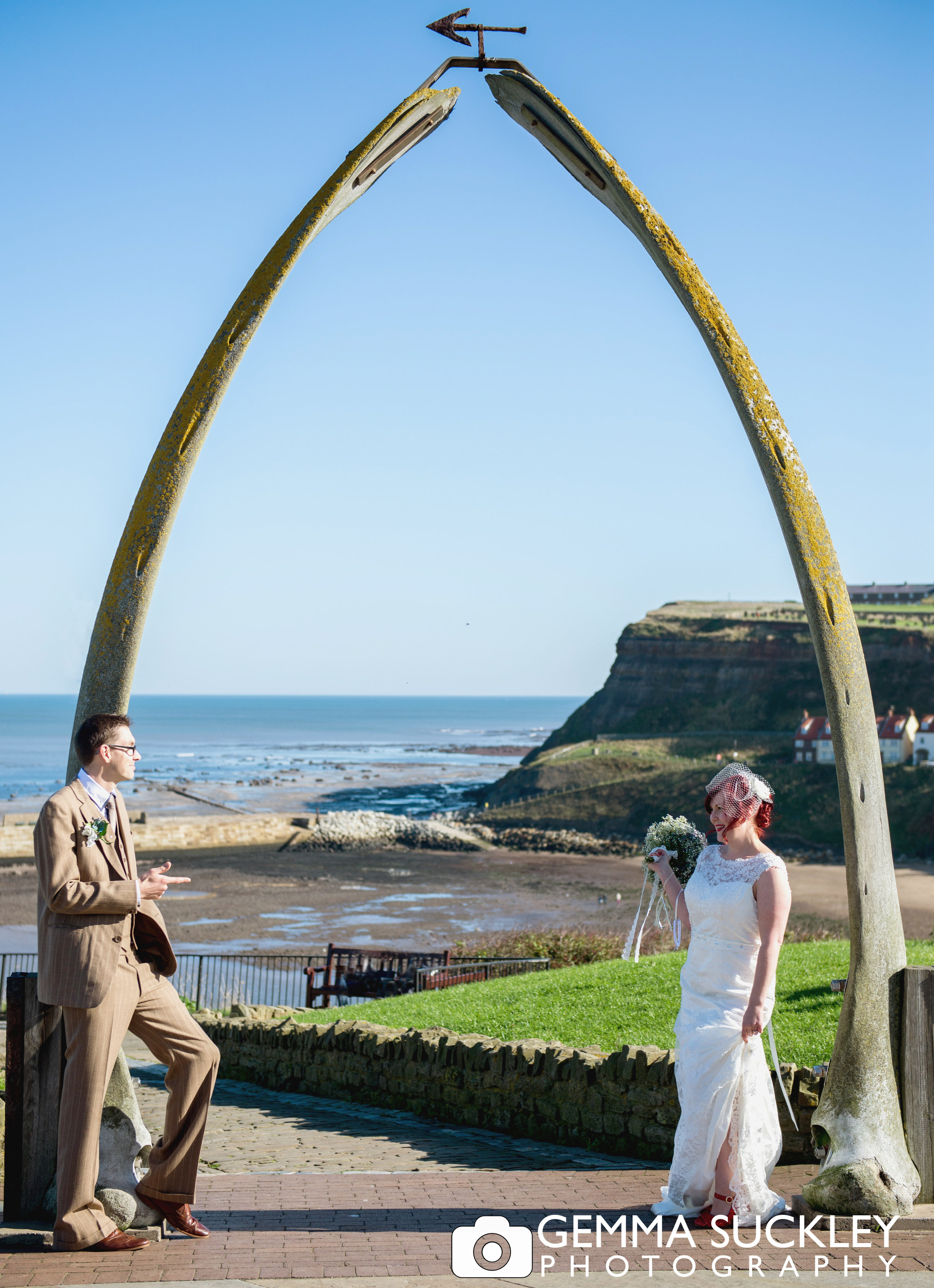 bride and groom under whitby whale bones
