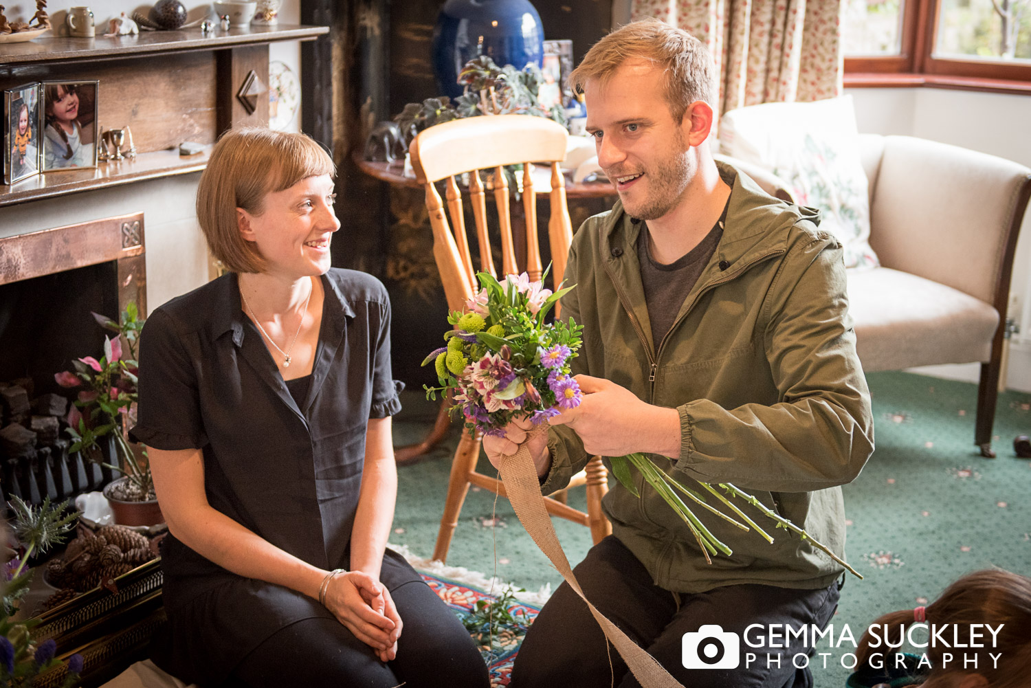a couple helping gather wedding flowers