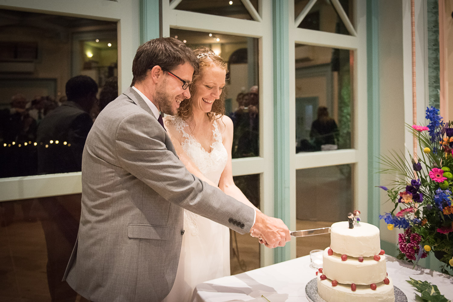 bride and groom cutting their wedding cake at Sun pavilion in Harrogate