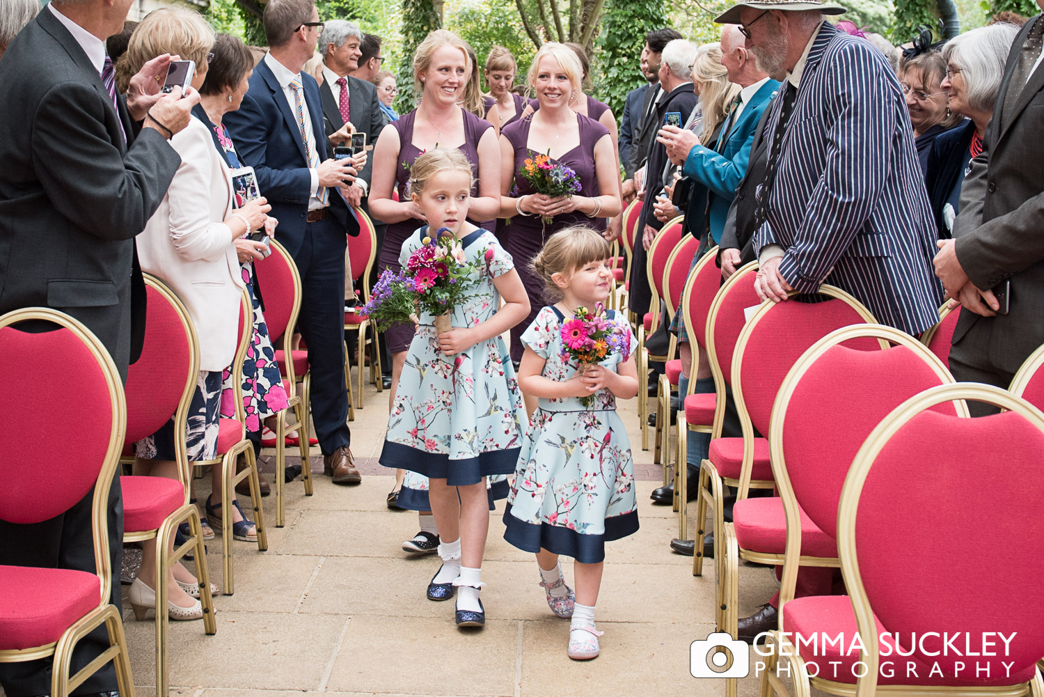 flower girls walking down the aisle at the Sun Pavilion