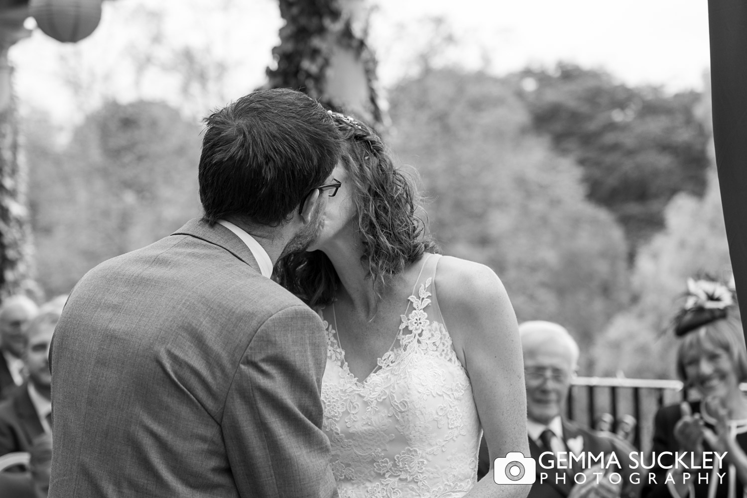 bride and groom kiss after wedding vows at Sun Pavilion