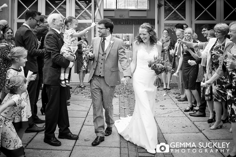 guests throwing confetti at Sun Pavilion, Harrogate wedding
