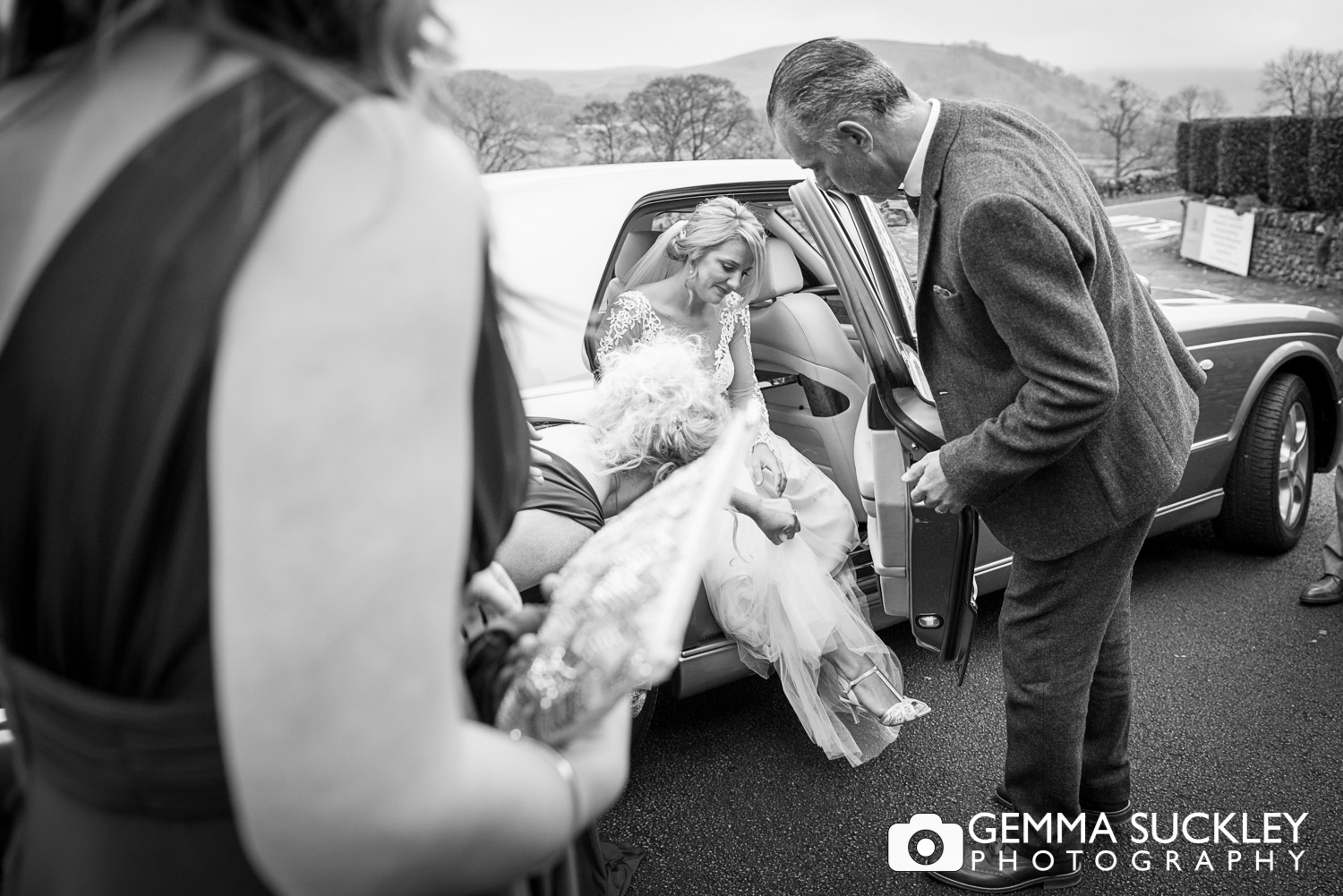 Bride getting out of the wedding car outside The Devonshire Fell in Burnsall