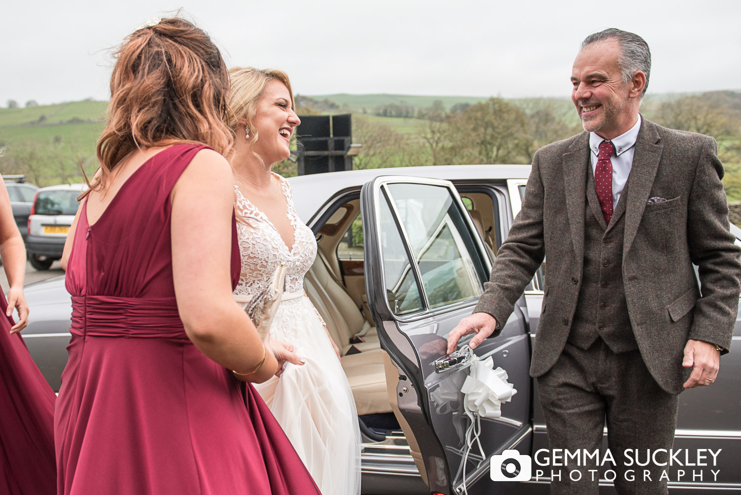 Bride getting out the wedding car at The Devonshire Fell in Burnsall