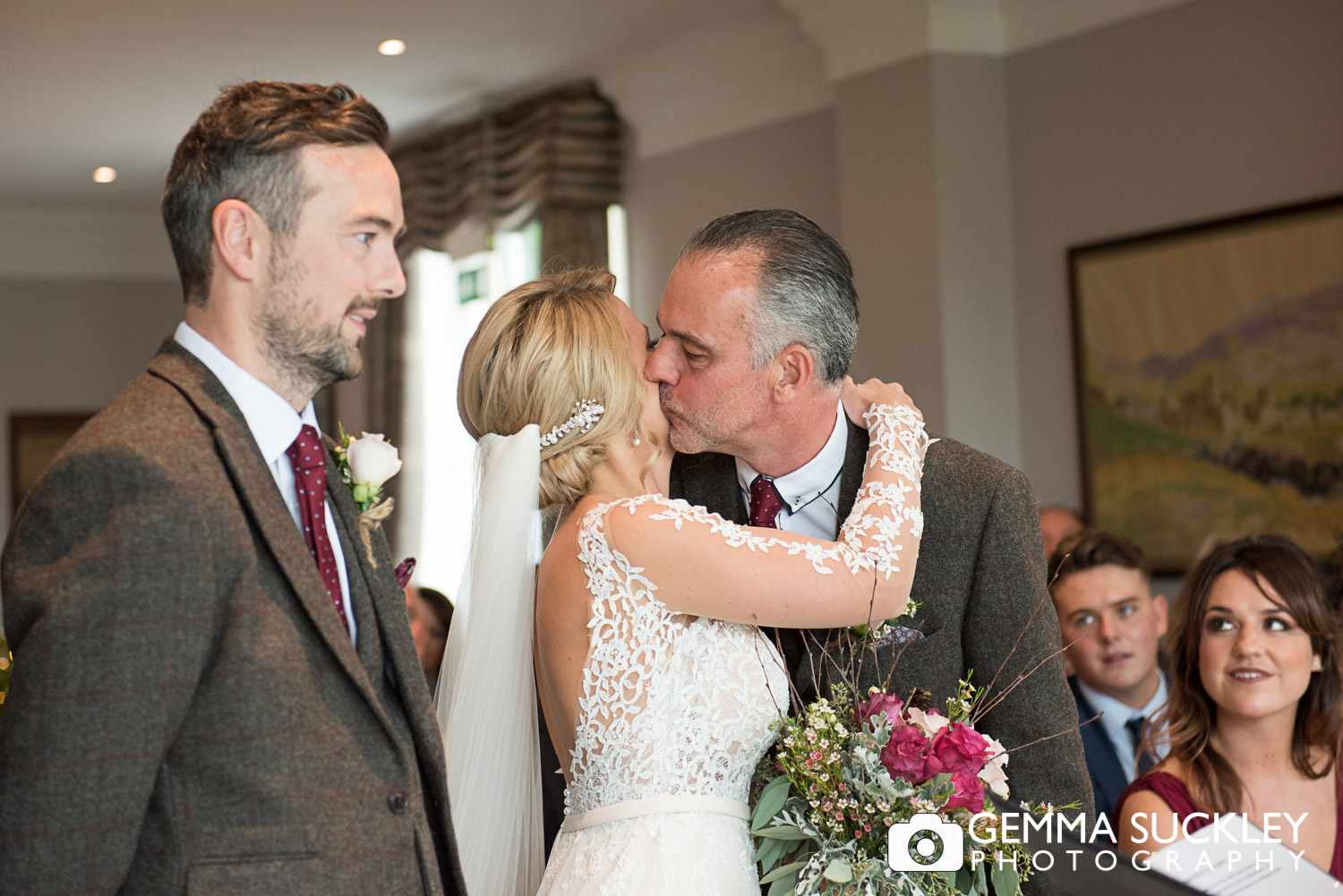 father of the bride kissing his daughter at the Devonshire Fell Ceremony