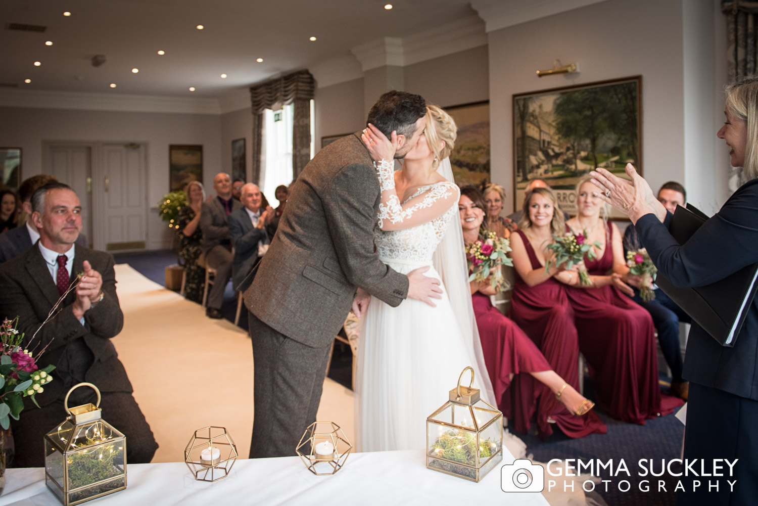 bride and groom's first kissing at The devonshire Fell in Burnsall