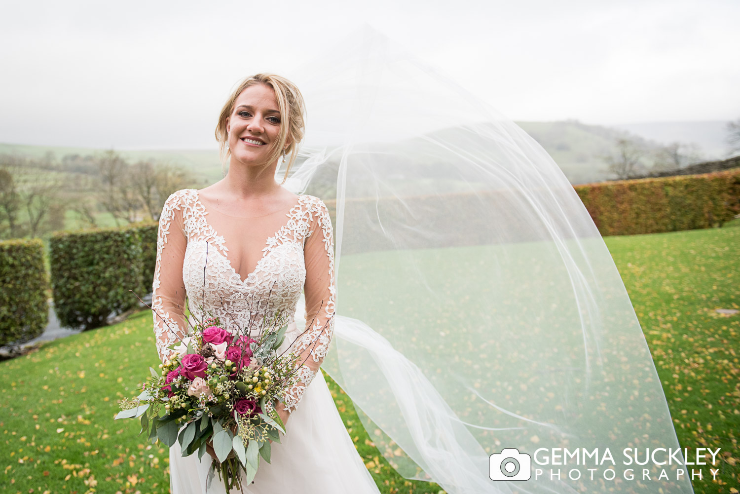 the brides veil blowing in the wind outside The Devonshire Fell in Burnsall