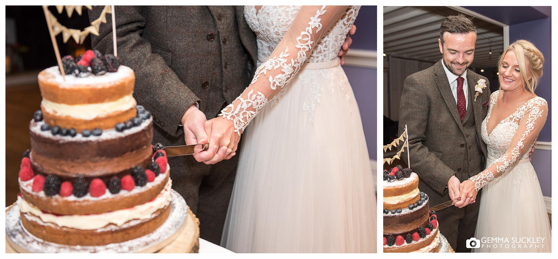 cake-cutting-burnall-Devonshire-fell-wedding.JPG
