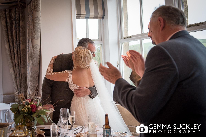 bride hugging her dad at burnsall wedding