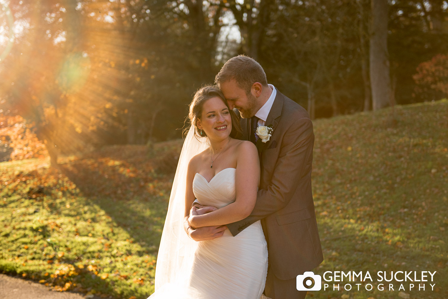 Bride and groom hugging at Consiton Hall during golden hour