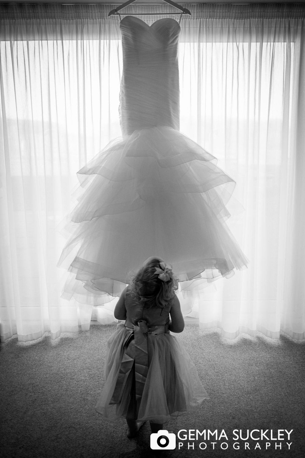 flower girl look up at wedding dress at Coniston hotel