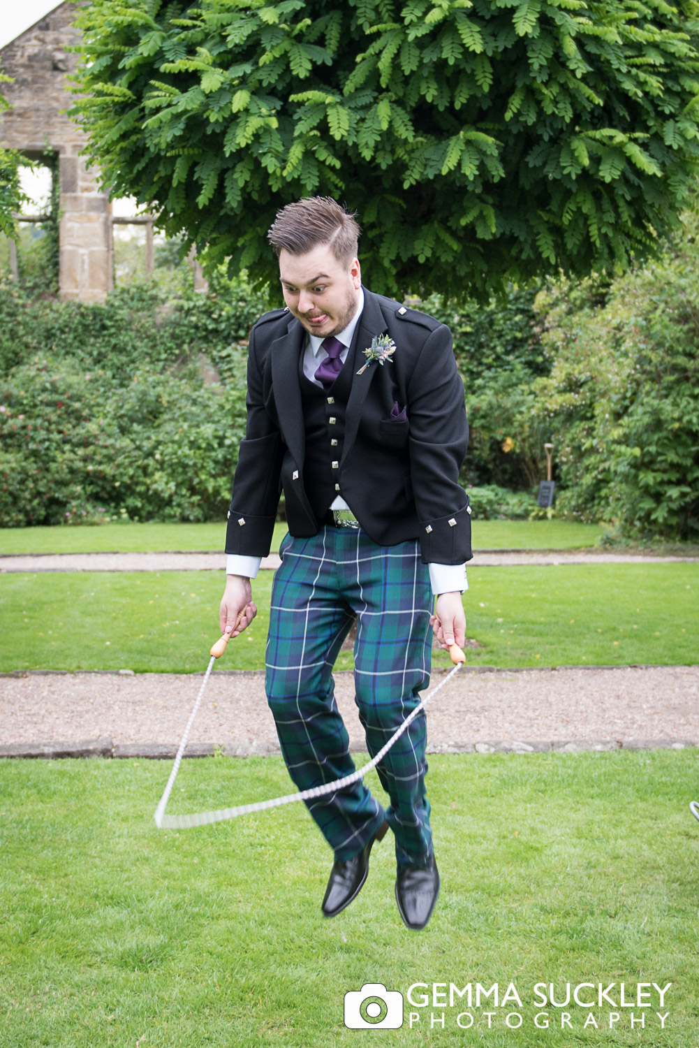 groom skipping at East riddlesden hall