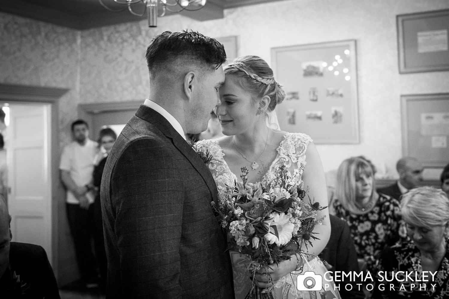 an intimate moment of a bride and groom during their ceremony at grassington house