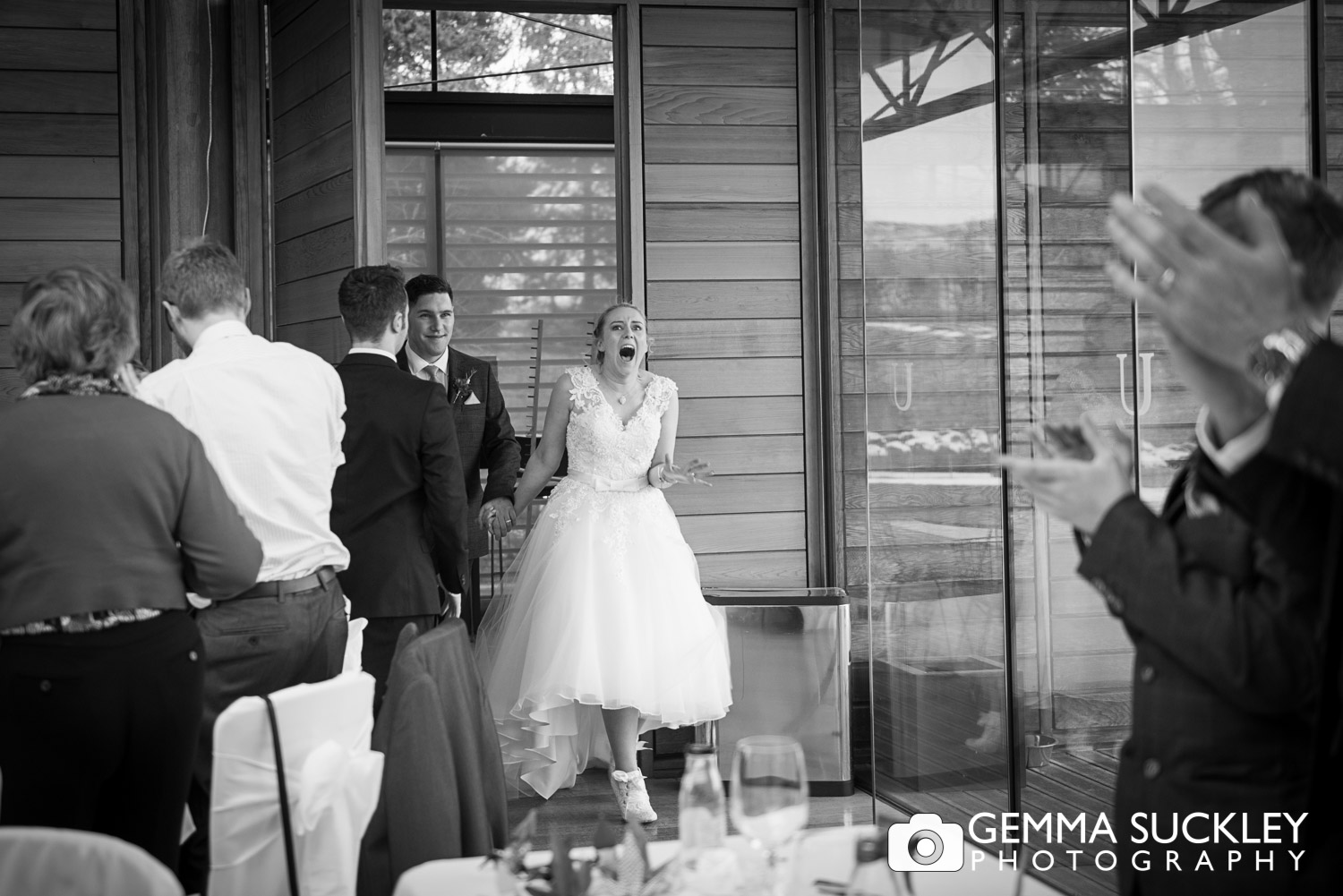 bride and groom looking exciting greeting by guests at utopia in skipton