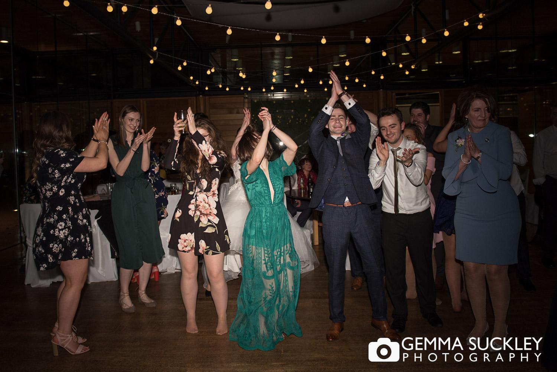 wedding guests dancing at utopia wedding reception