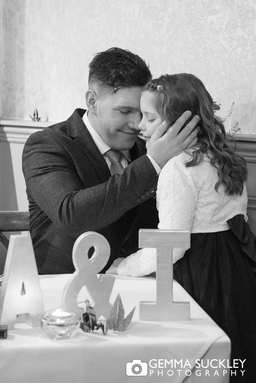 groom hugging his child during his wedding ceremony at Grassington House