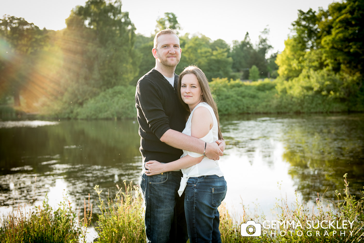 a couple by the lake at golden hour during theit photo shoot at coniston hotel