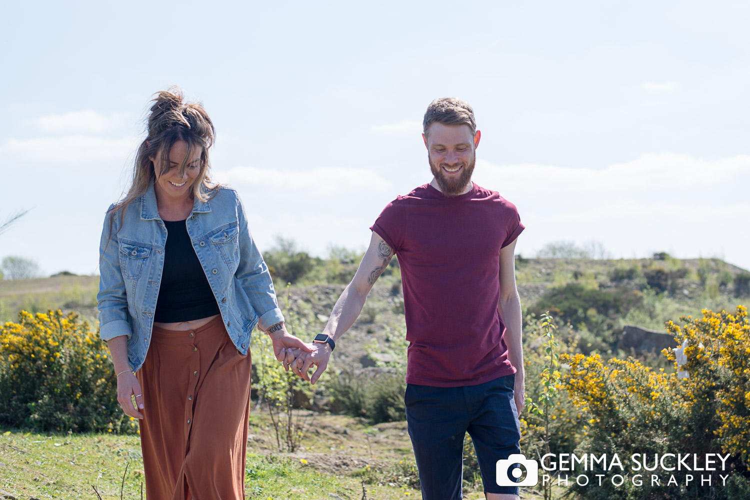engaged couple walking holding hands during pre-wedding photo shooting in halifax