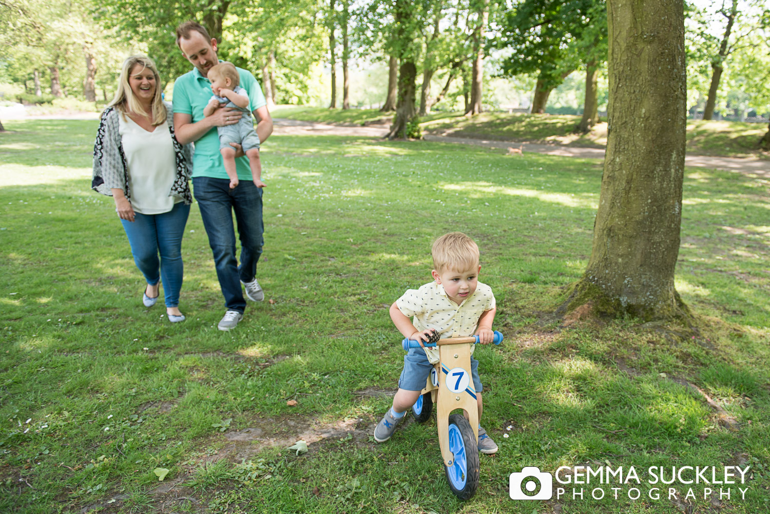 little boy on scooter during a natural family photo shoot in north yorkshire