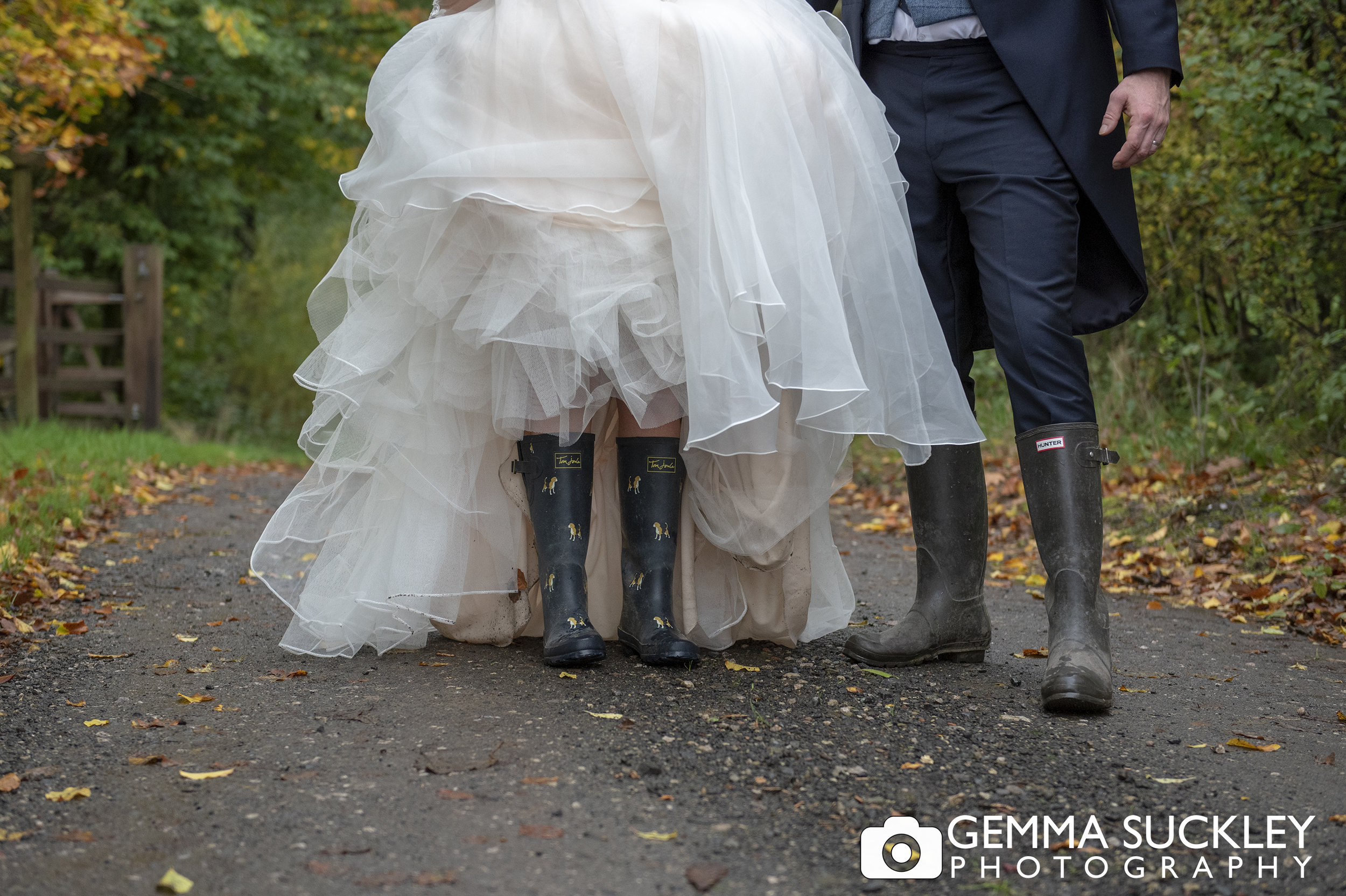 close up wedding photo of bride and groom wellies at the out barn in Clitheroe