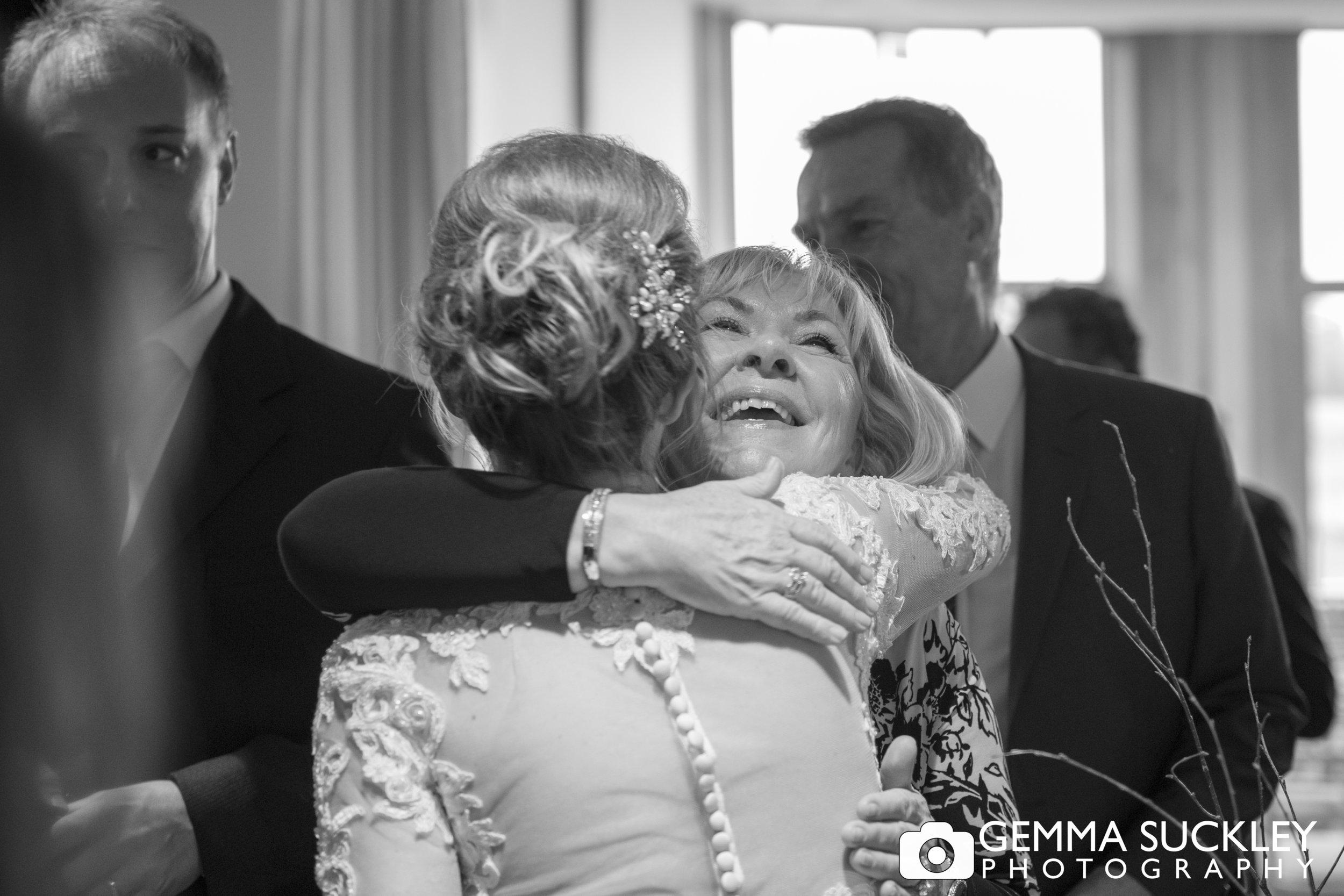 bride hugging wedding guest at Grassington house wedding