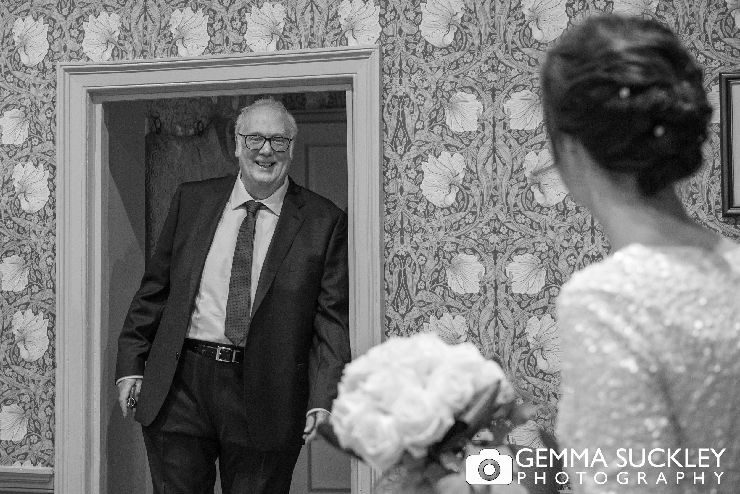brides father entering the room smiling as he sees his daughter at the devonshire hotel in bolton abbey