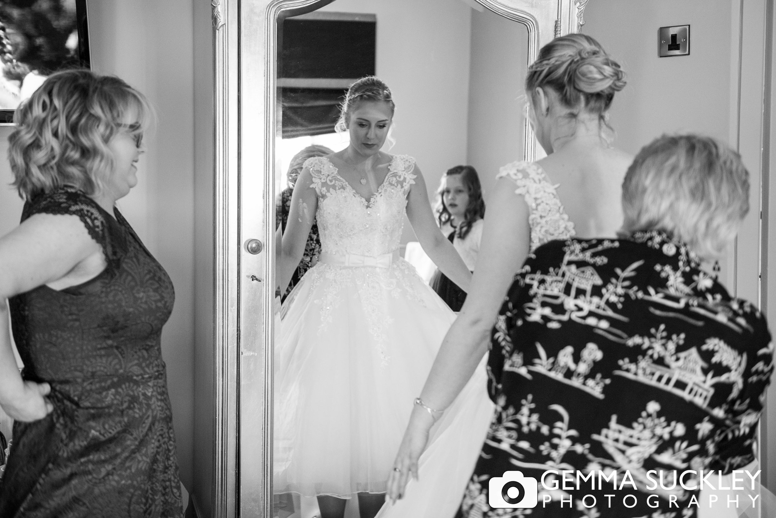 black and white photo of bride in her wedding dress