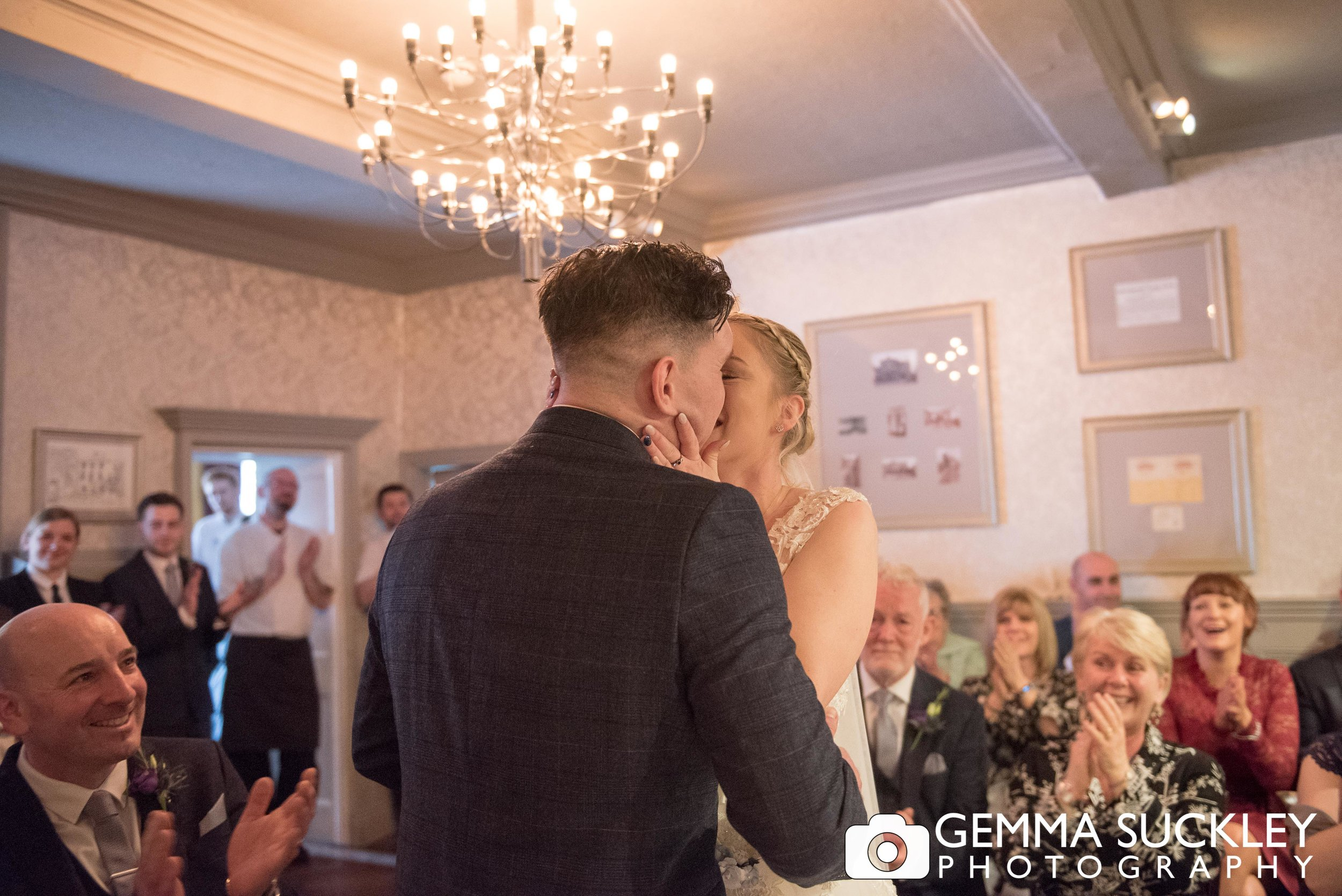groom kissing his bride at grassington house wedding