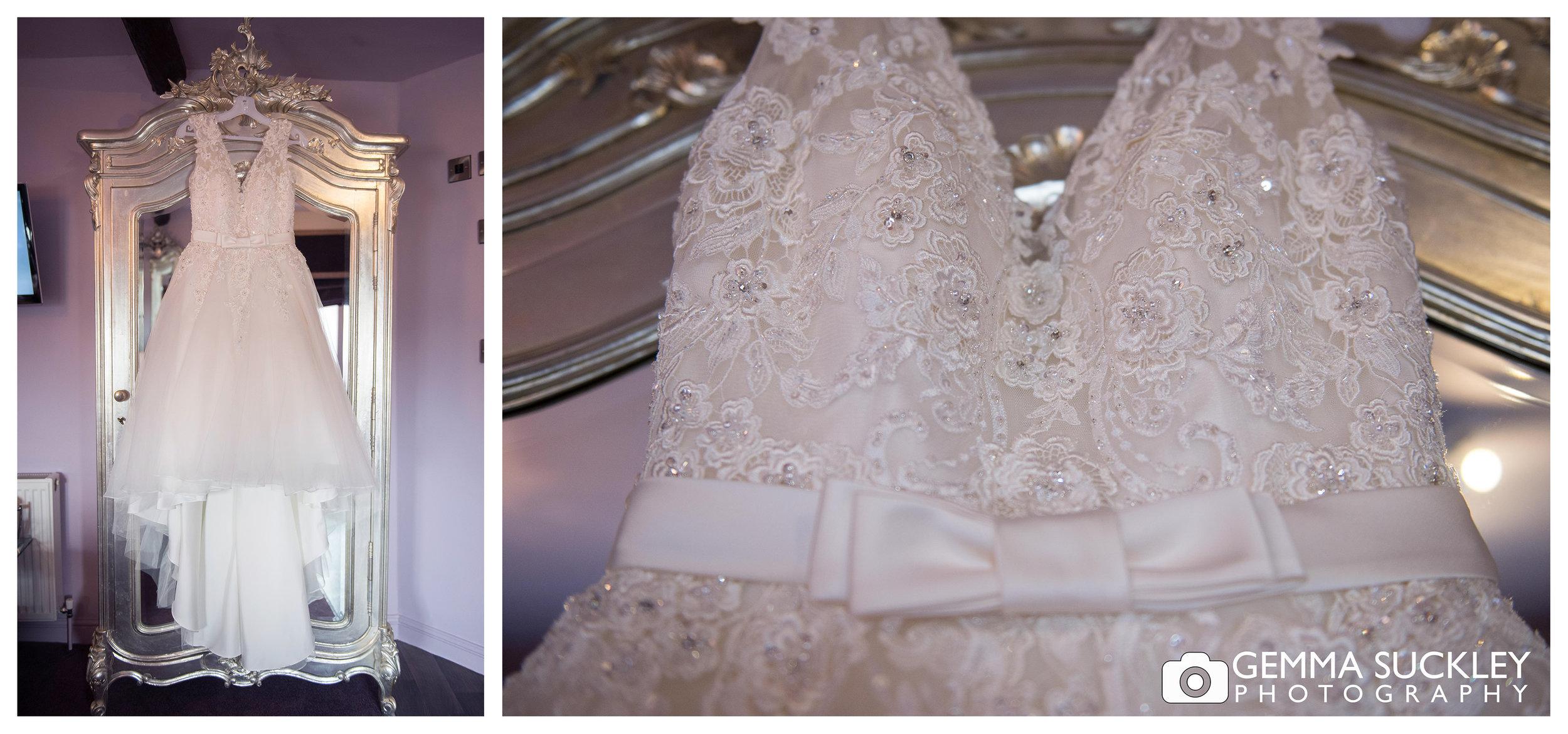 wedding photo of a amelias wedding dress hanging at grassington house