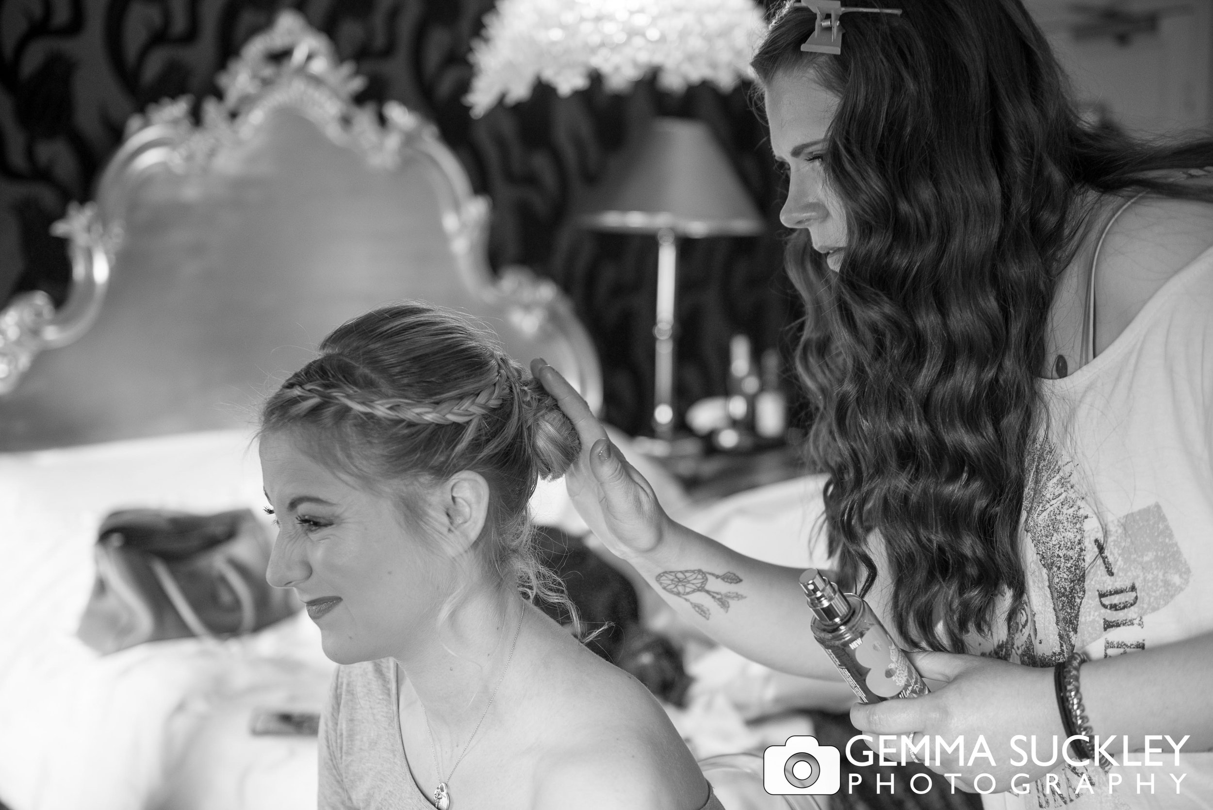 natural photo of bride getting the hair done at grassington house