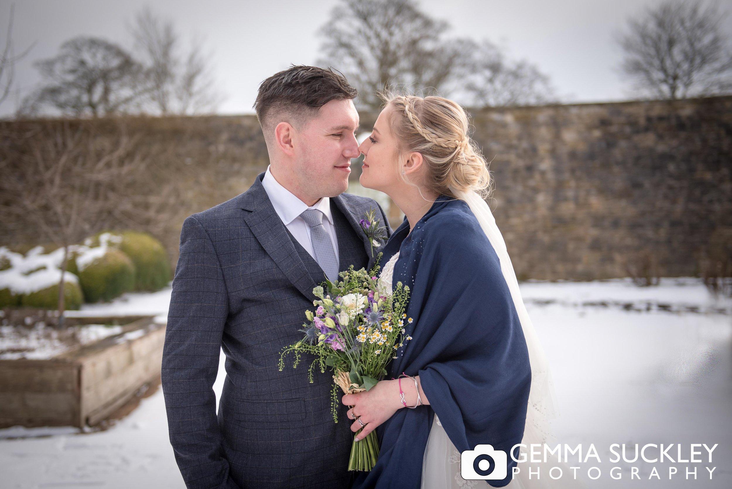 bride and groom at utopia snowy wedding