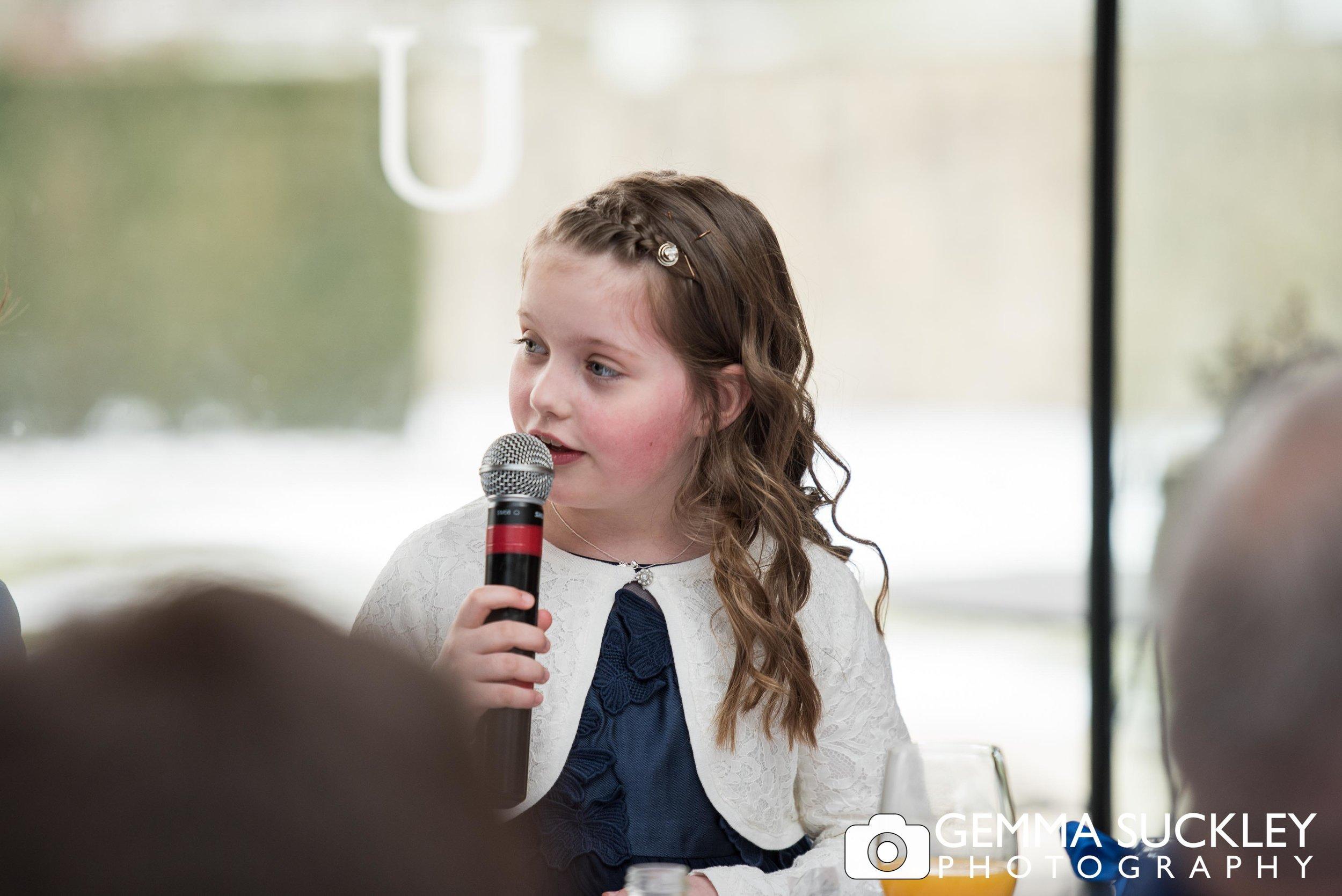 little flower girl making a speech at utopia wedding