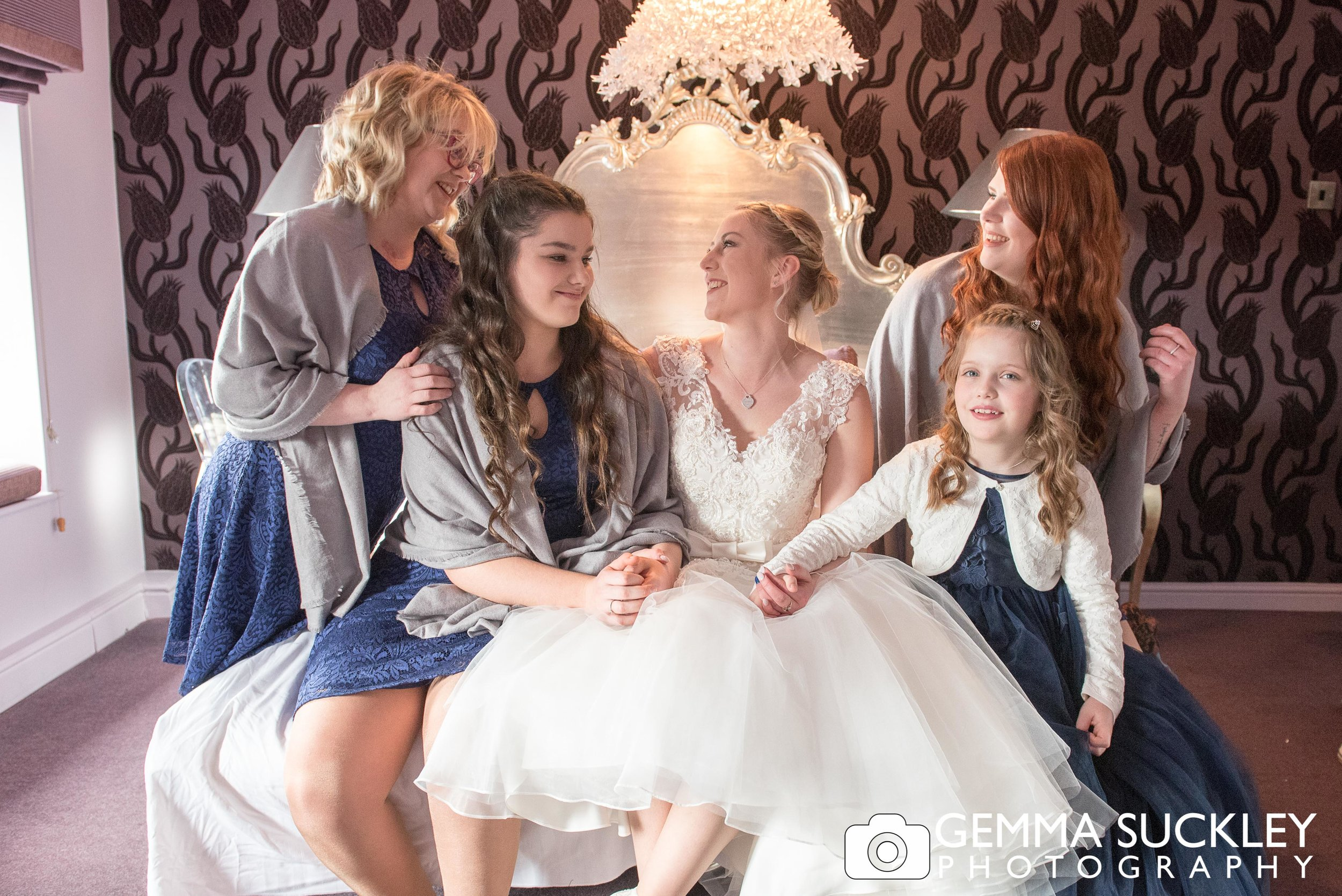 bride with her bridemaids natural wedding photo at grassington house