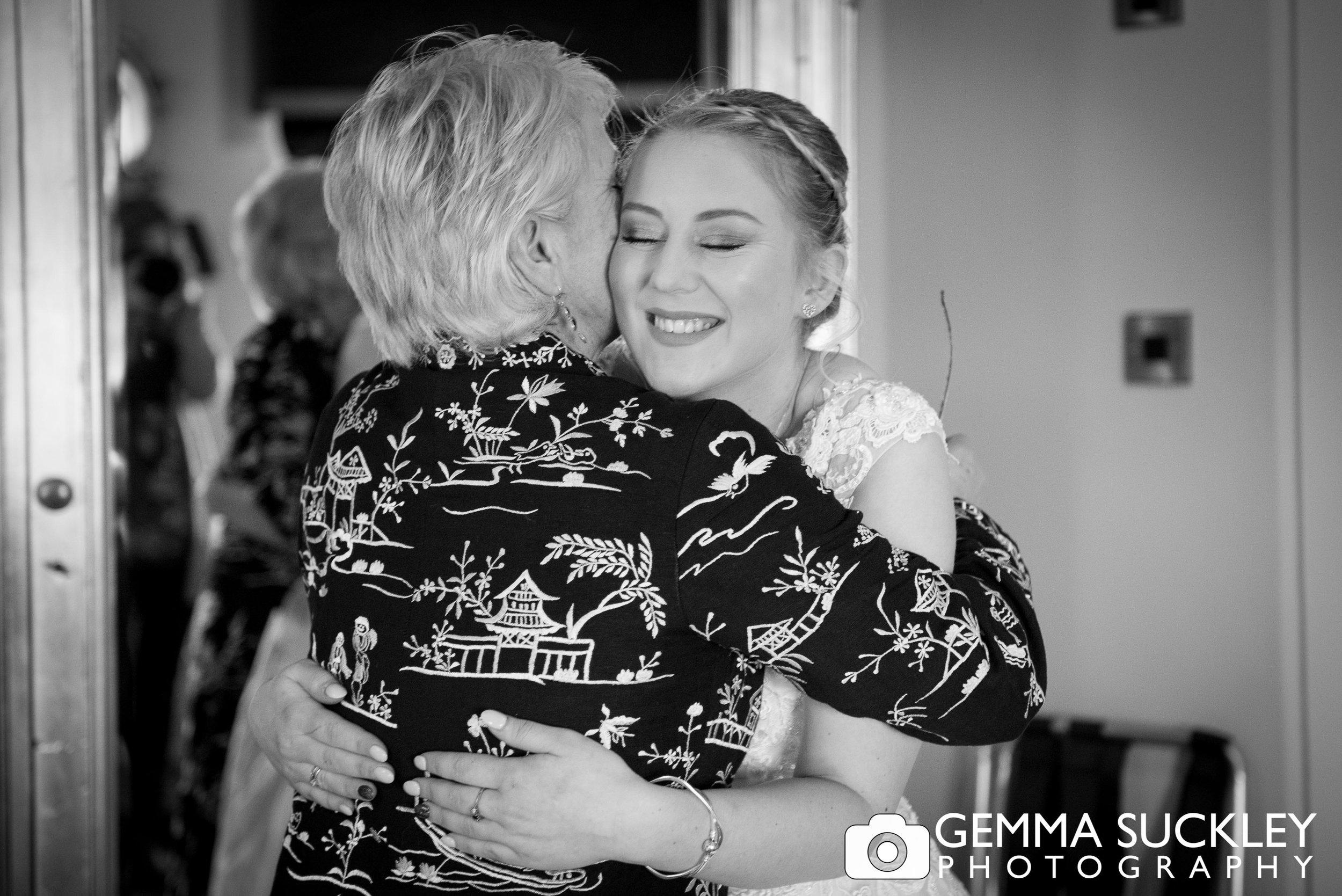 bride hugging her mum at grassington house