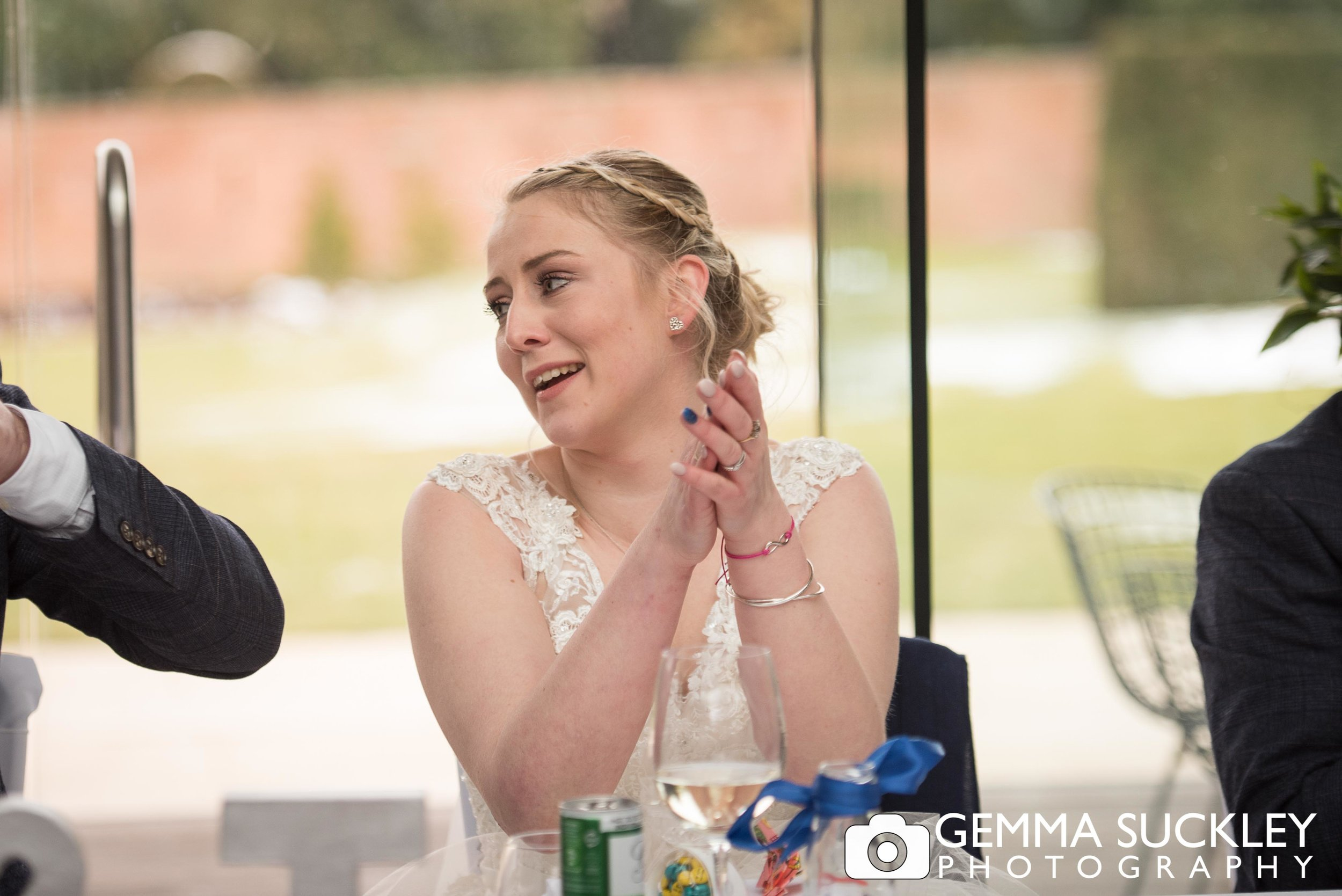 bride clapping at utopia at broughton hall wedding