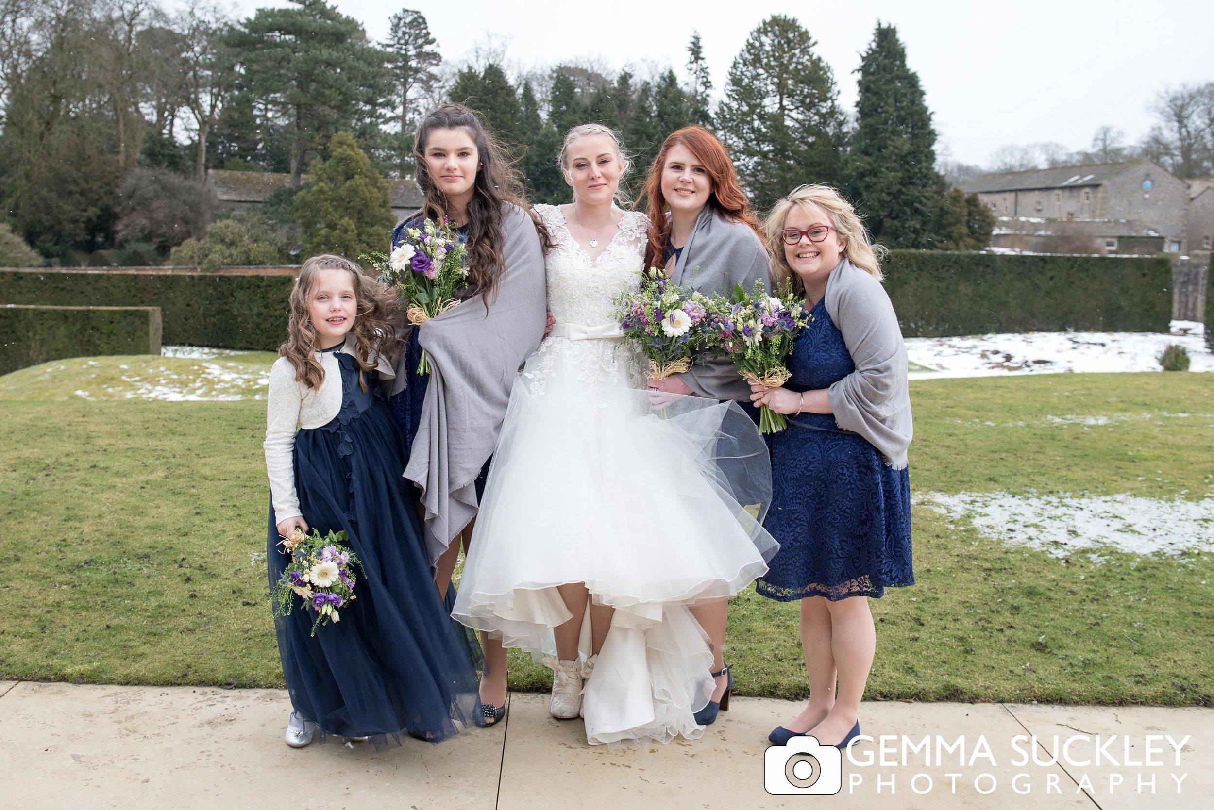 bride with bridesmaids at utopia wedding