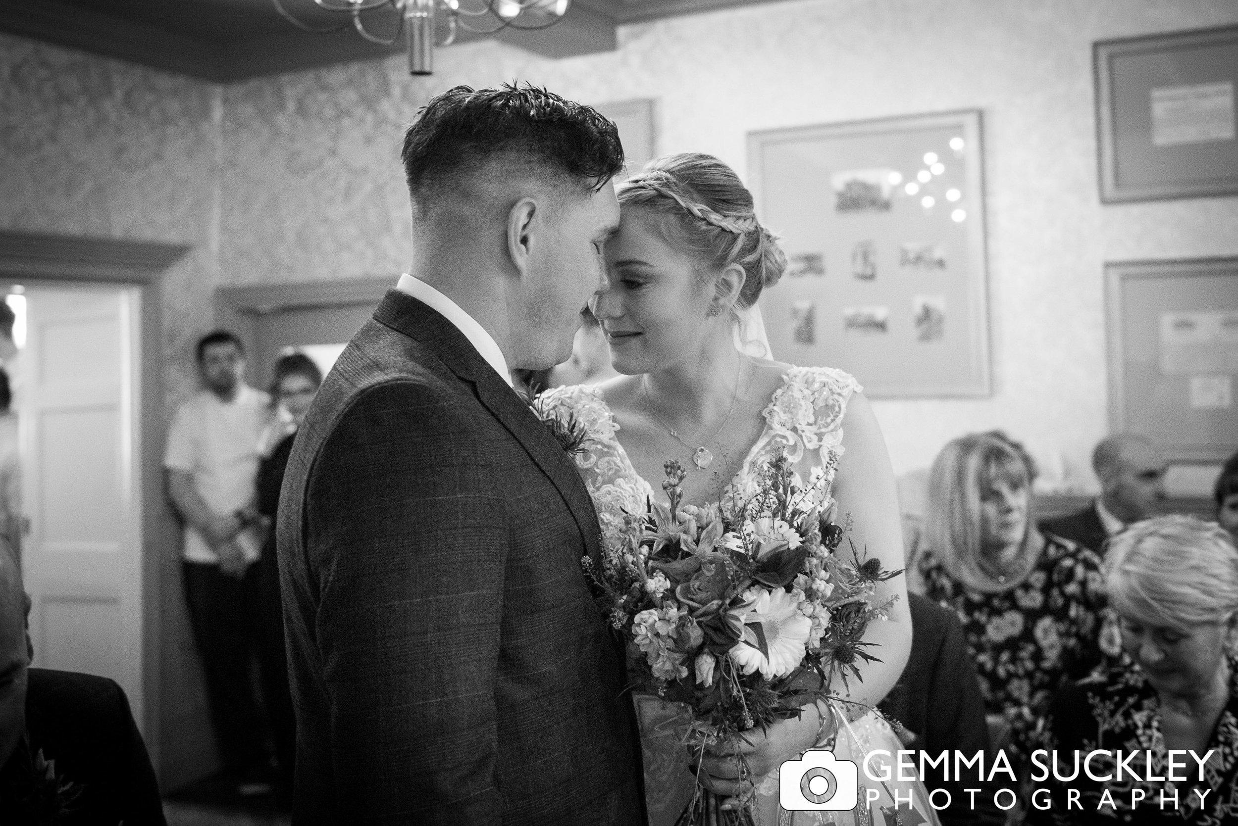 emotional photo of bride and groom during grassington house wedding ceremony