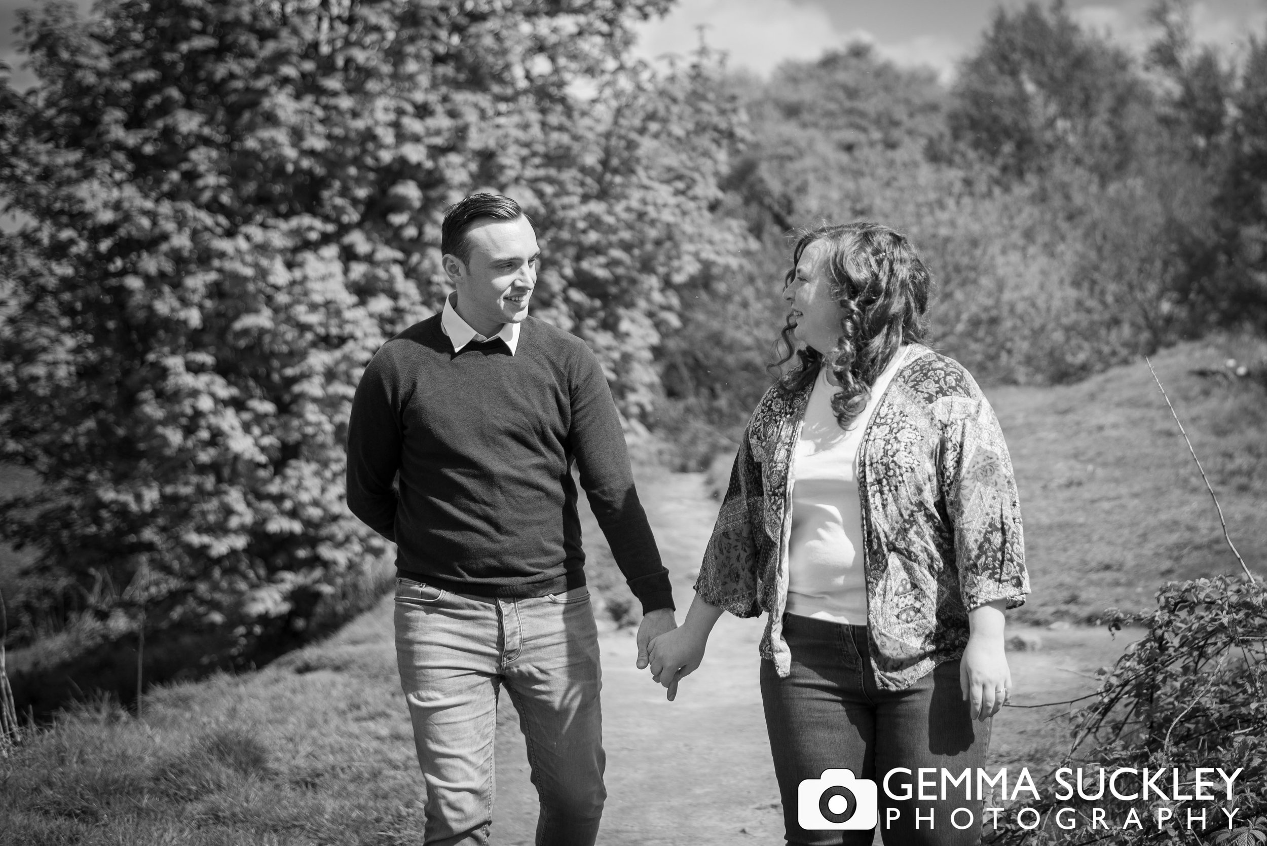 black and white photo of a couple holding hands at the otley chevin