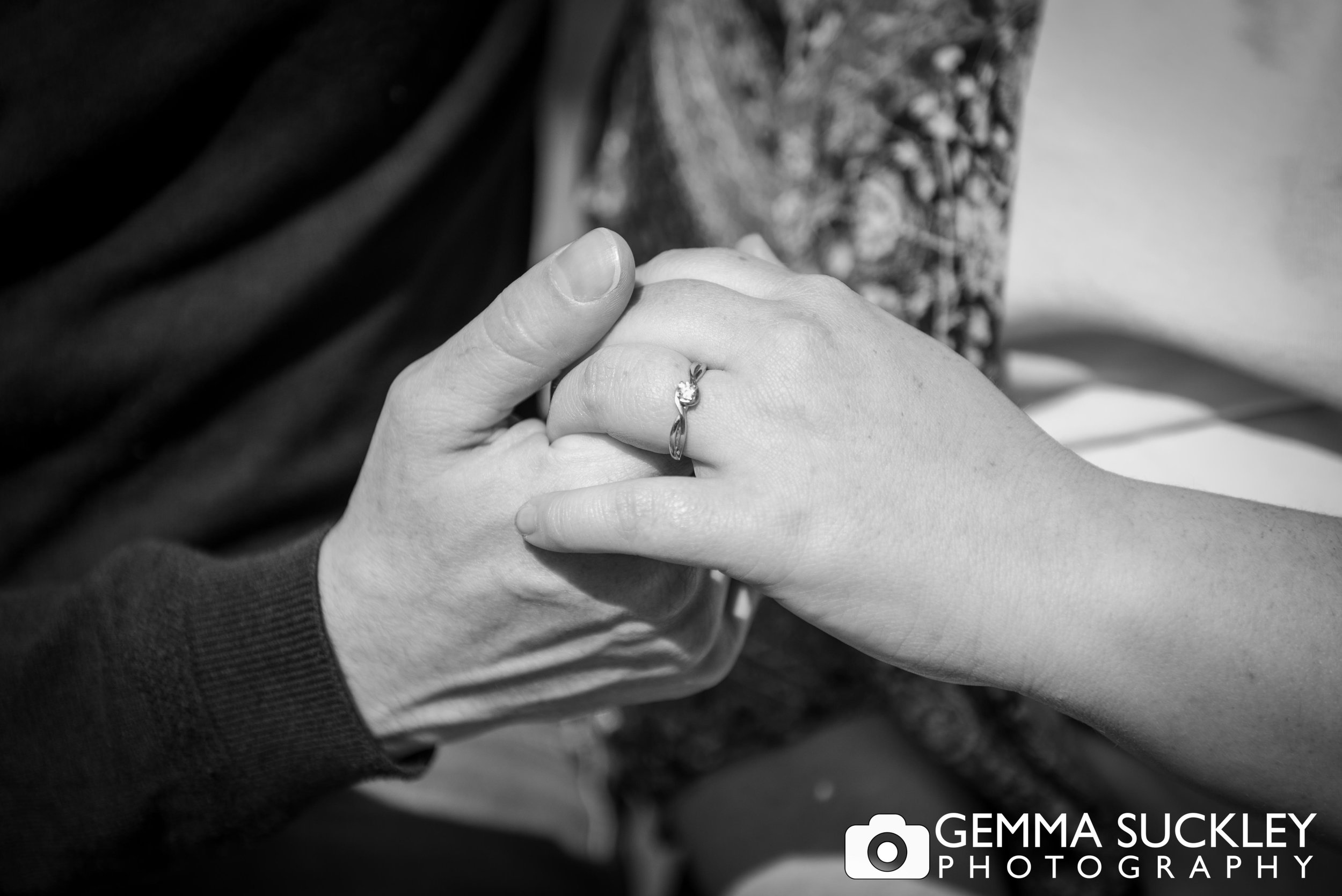 photo of engagement rings couple holding hands