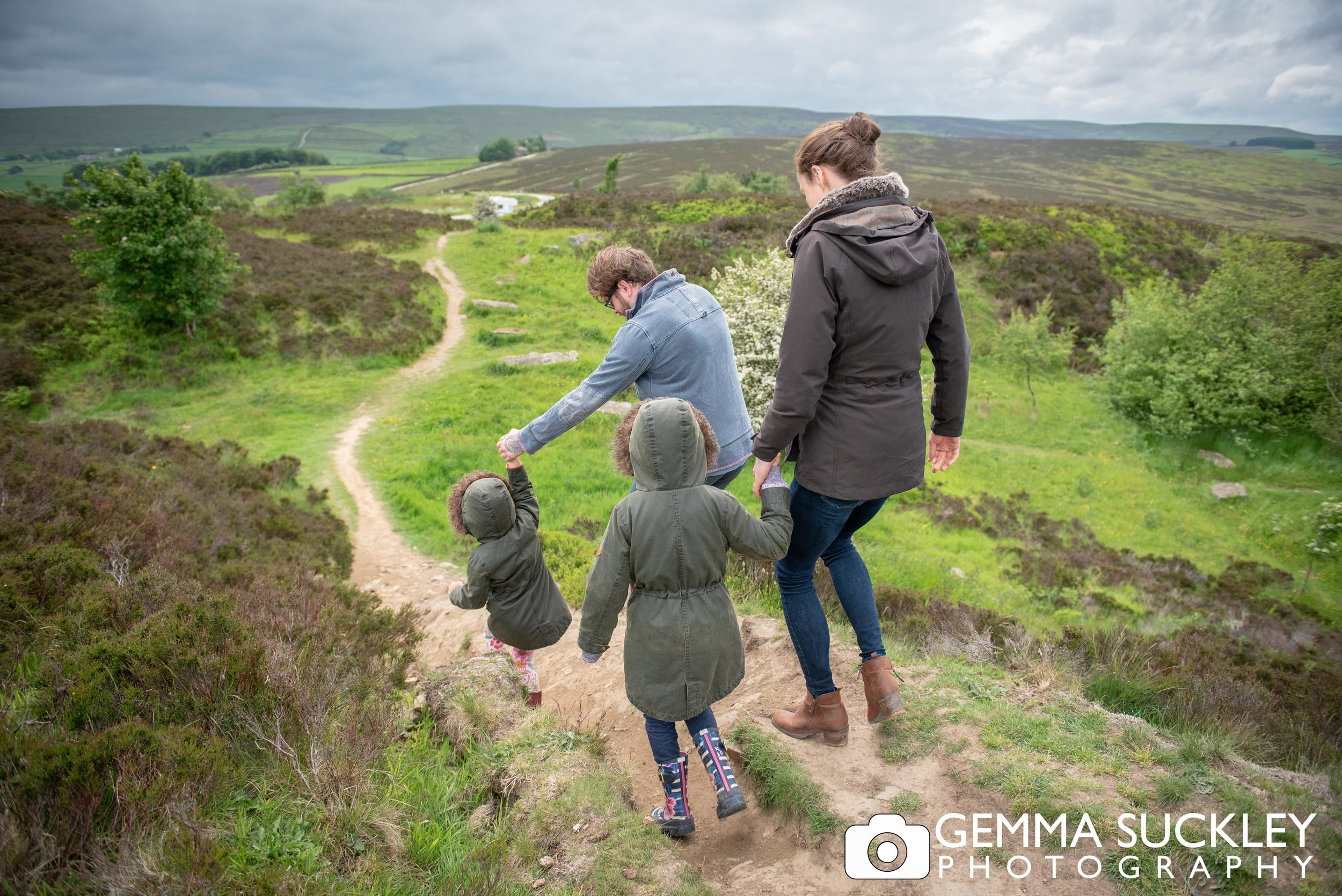 colourful photo of a family walking on haworth moor