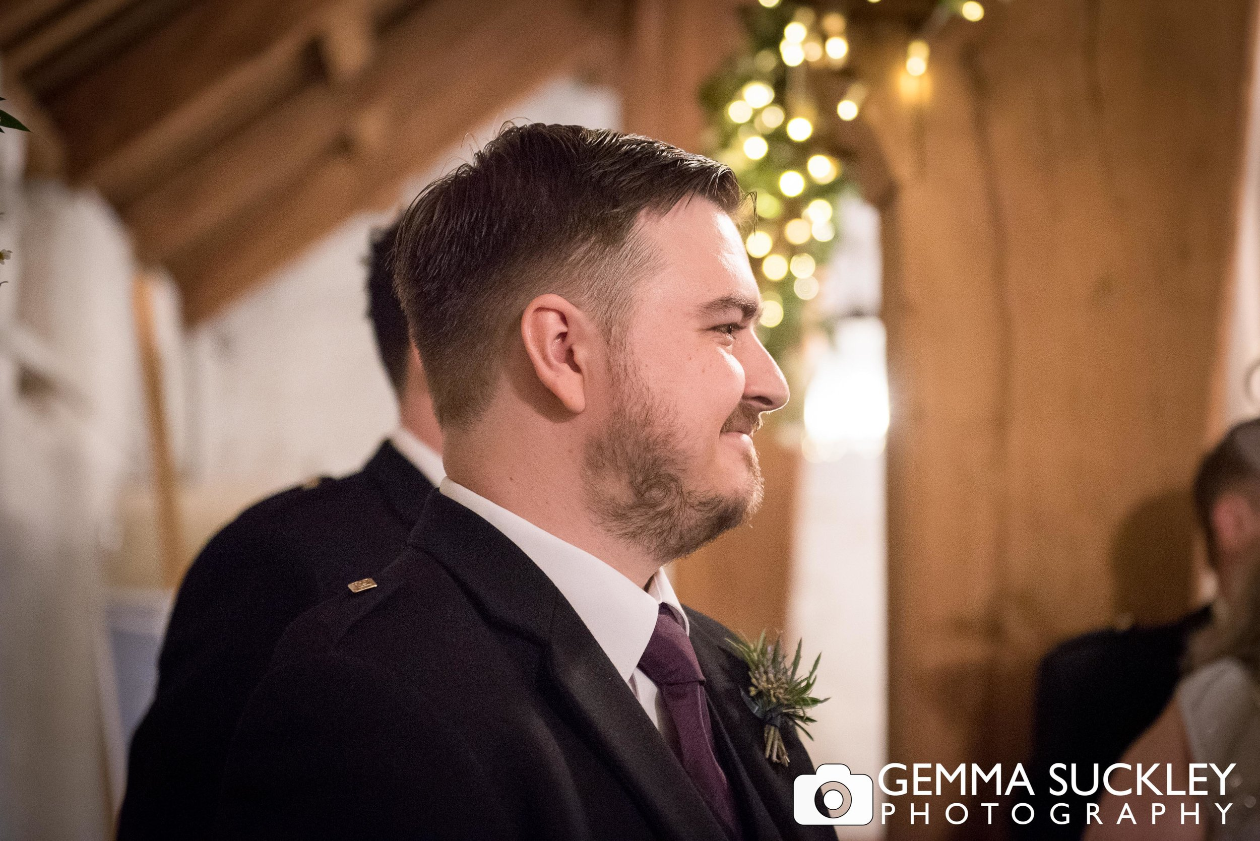 close up photo of the groom at east riddlesden hall