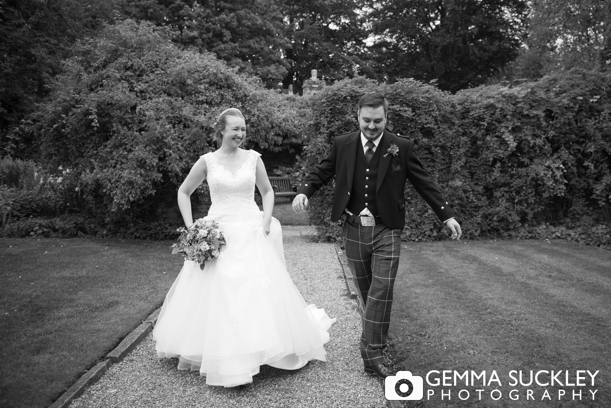 black and white photo of the bride and groom in the gardens of east riddlesden hall