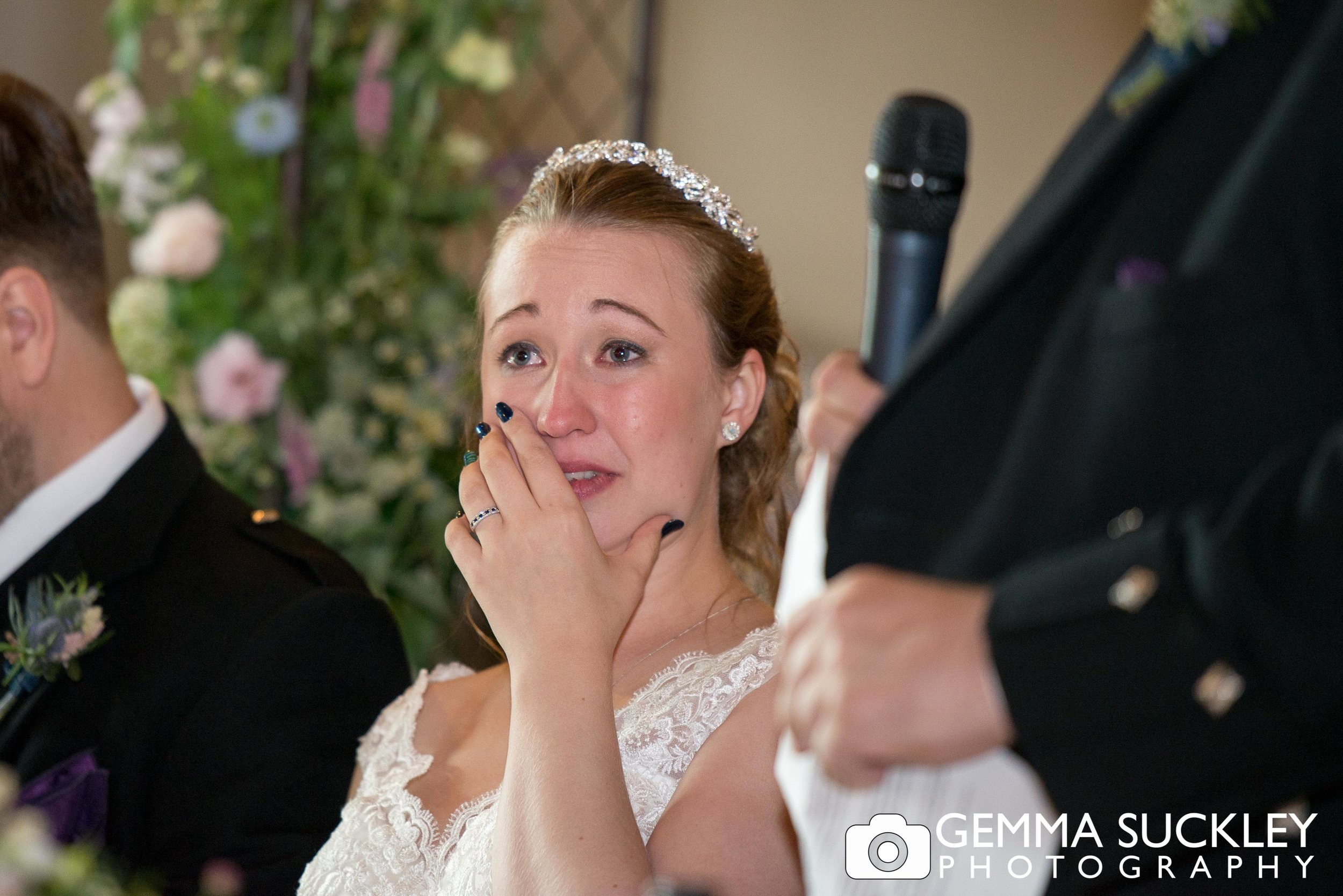 bride crying during her dad's wedding speech
