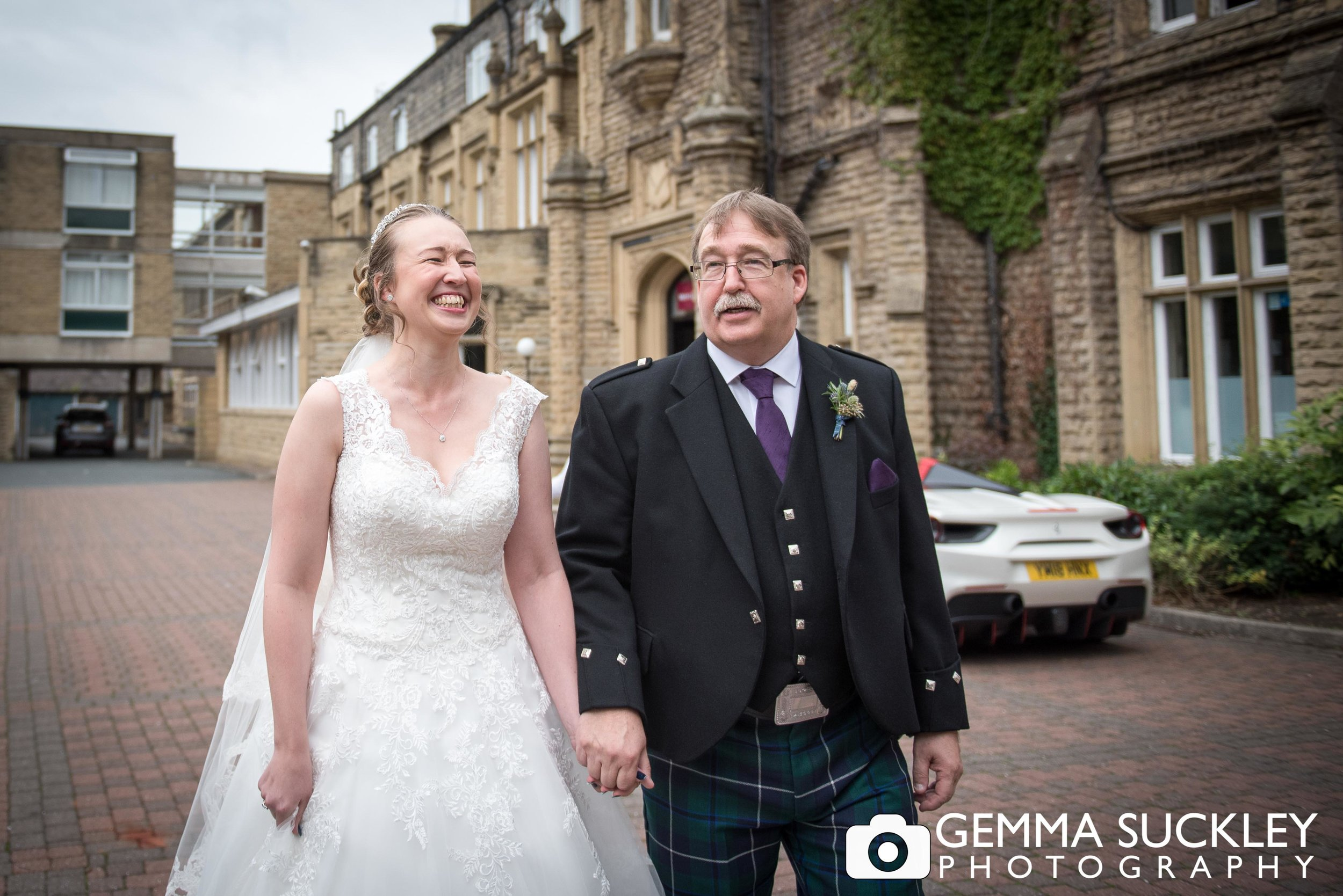 bride with her dad leaving the mercure hotel for her wedding
