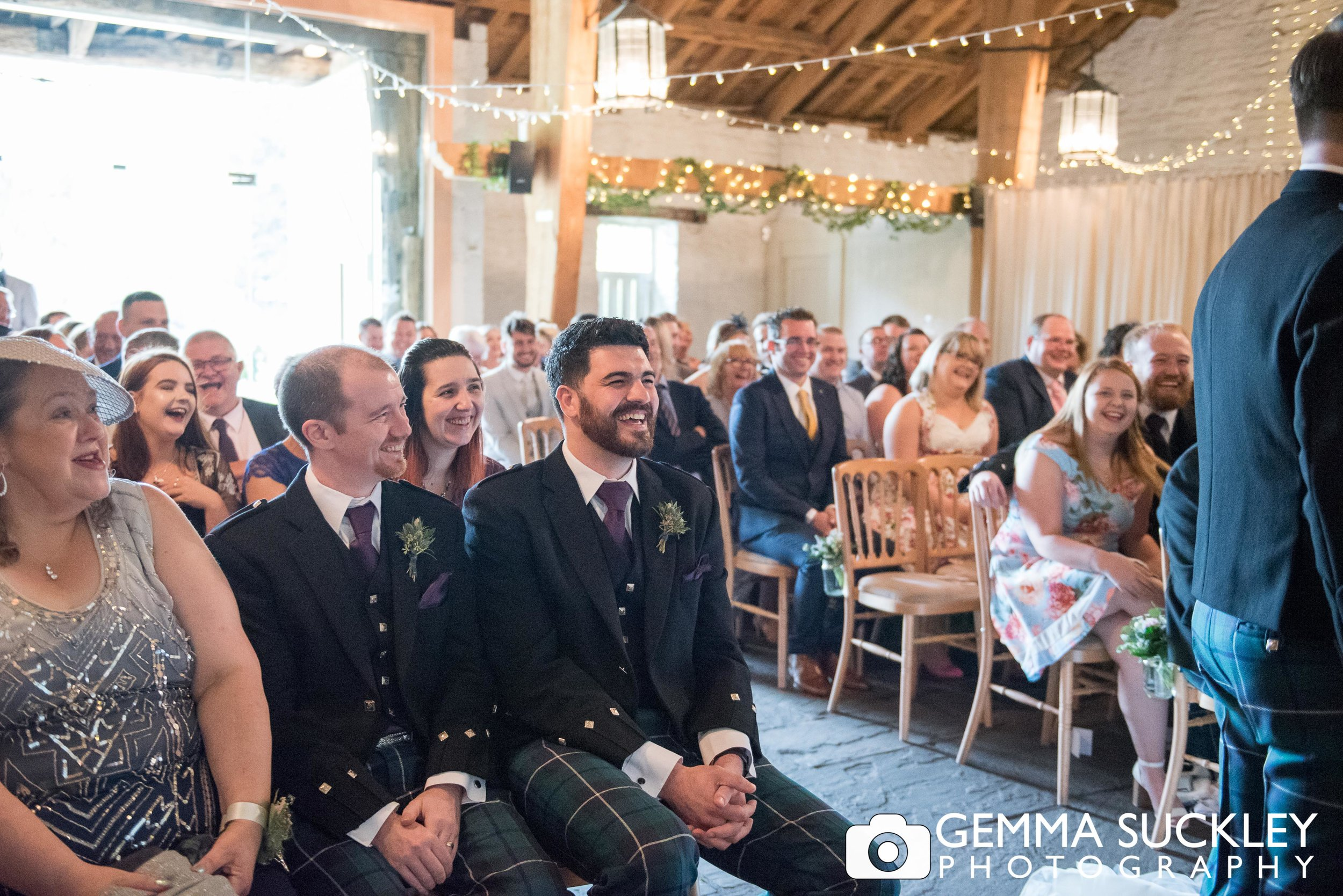 wedding guests laughing at east riddlesden hall